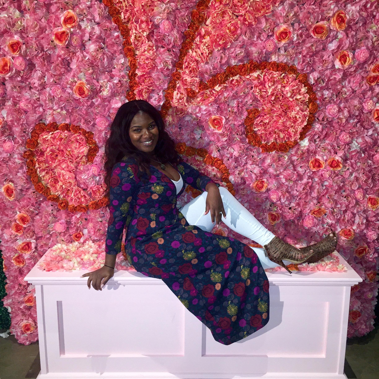 black-desti-black-destination-bride-host-bridefriends-guide-to-destination-weddings-podcast-flower-background.jpg