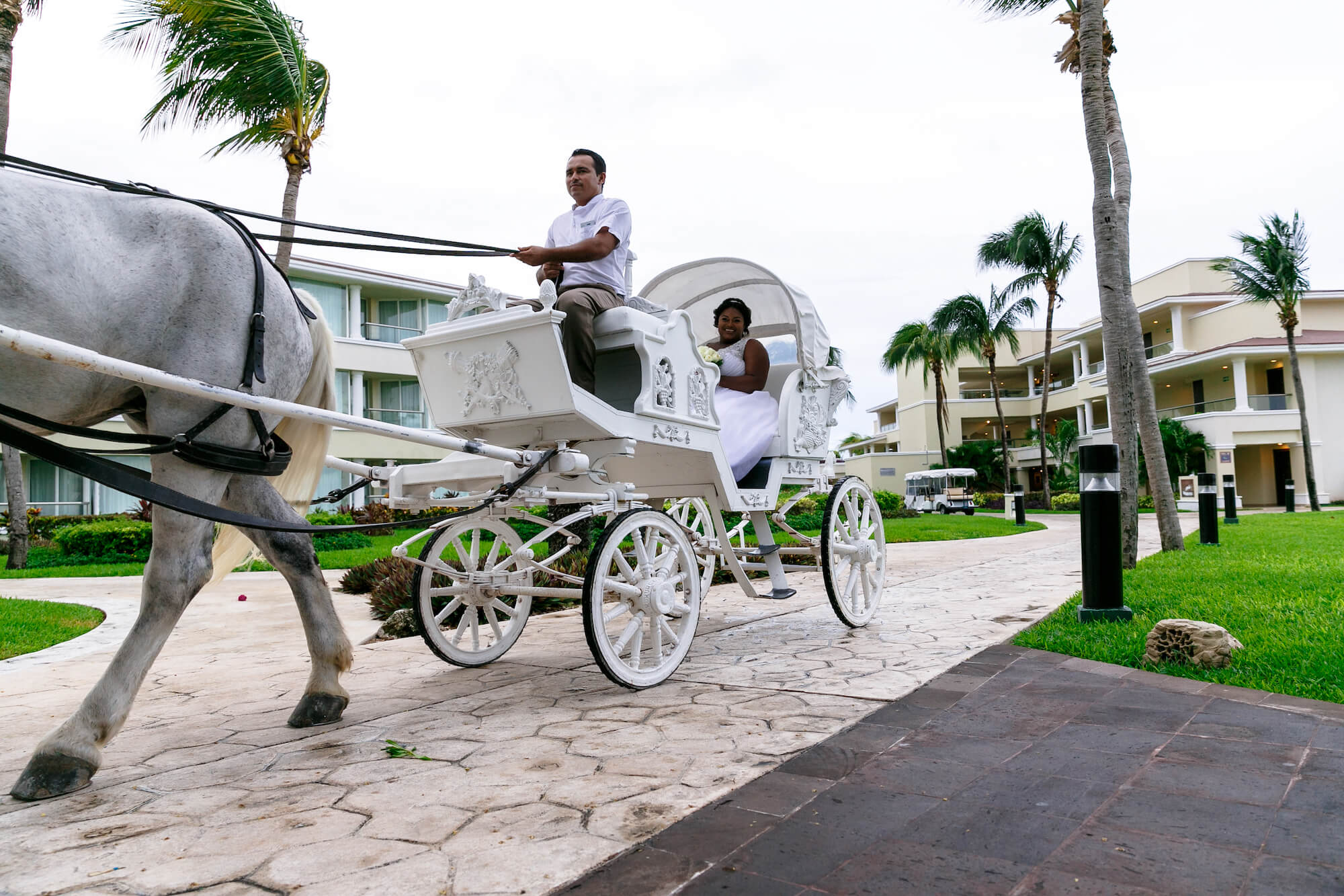 tressa-how-to-plan-a-destination-wedding-in-cancun-mexico-moon-palace-resort-black-destination-bride-destiland-desti-guide-to-destination-weddings-horse-carriage.jpg