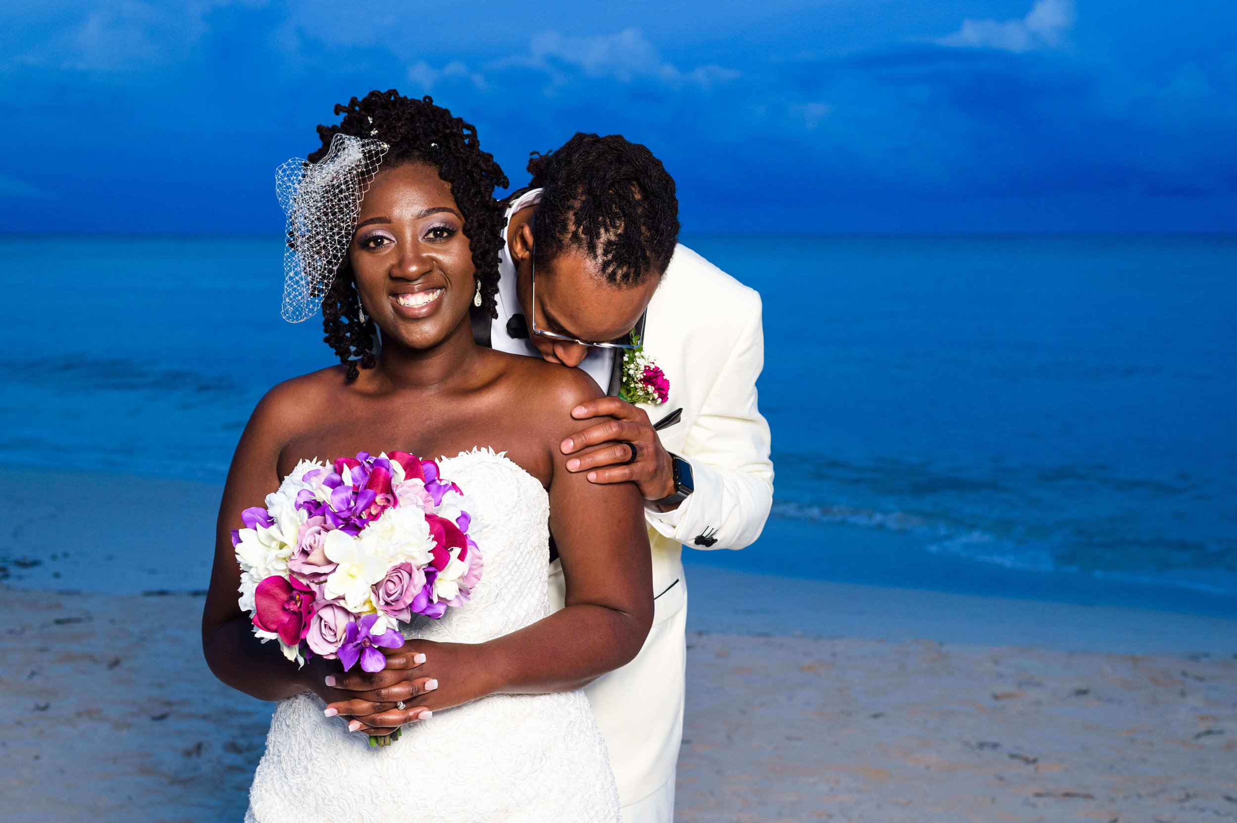 jamellah-how-to-plan-a-destination-wedding-in-montego-bay-jamaica-royalton-blue-waters-black-destination-bride-destiland-desti-guide-to-destination-weddings-couple-beach-after-ceremony.jpg