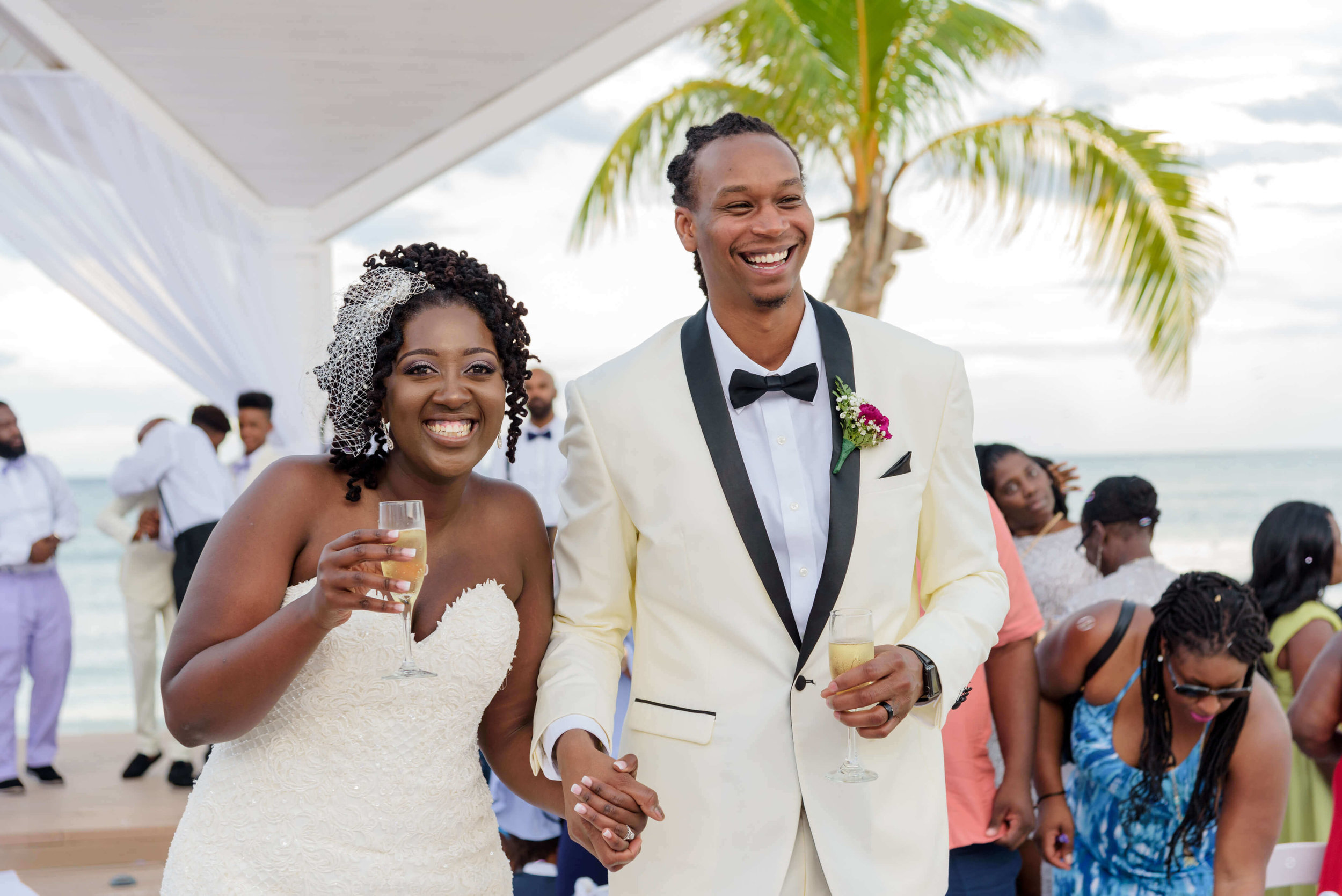 jamellah-how-to-plan-a-destination-wedding-in-montego-bay-jamaica-royalton-blue-waters-black-destination-bride-destiland-desti-guide-to-destination-weddings-couple-after-ceremony.jpg