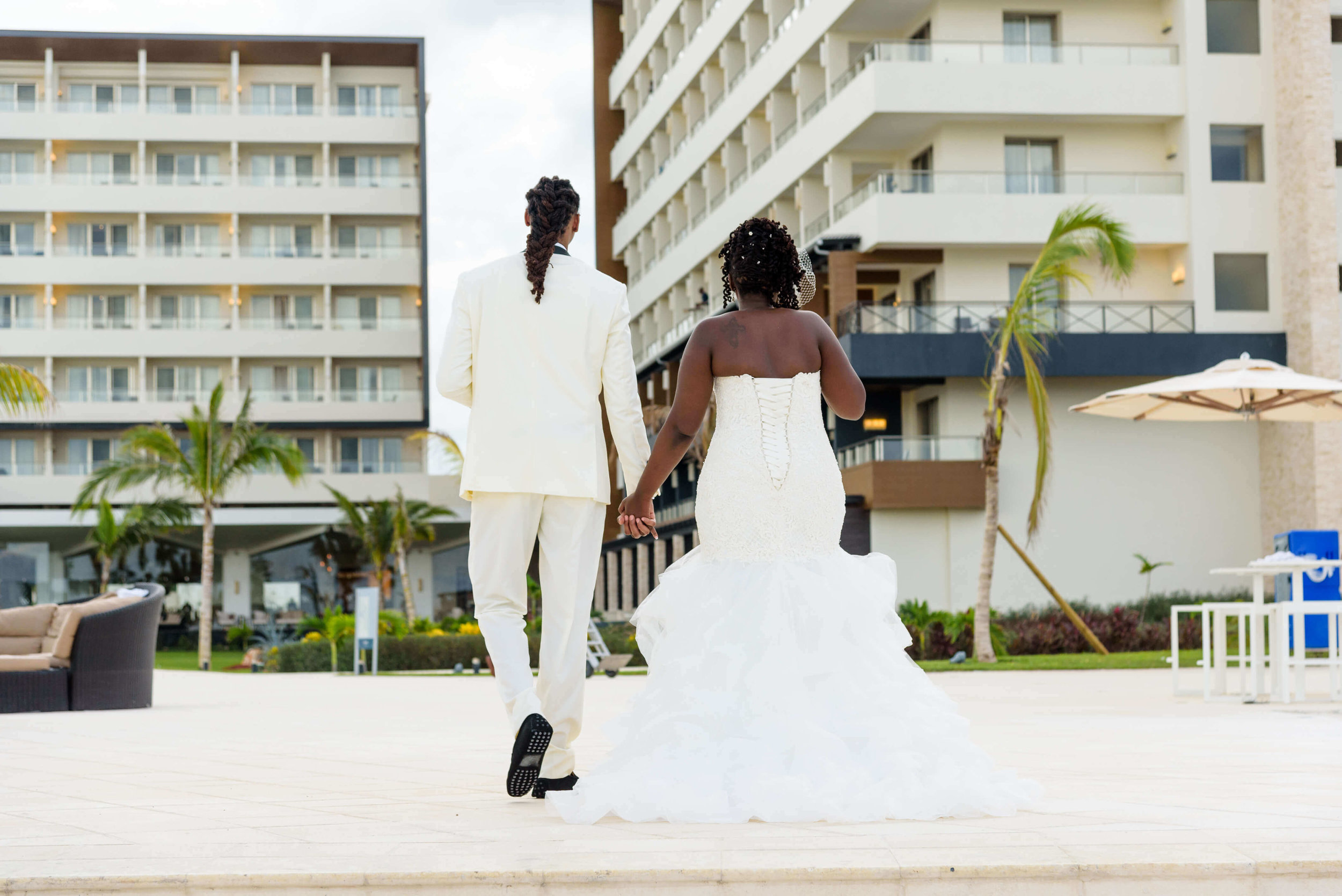 jamellah-how-to-plan-a-destination-wedding-in-montego-bay-jamaica-royalton-blue-waters-black-destination-bride-destiland-desti-guide-to-destination-weddings-couple-after-beach-ceremony-back.jpg
