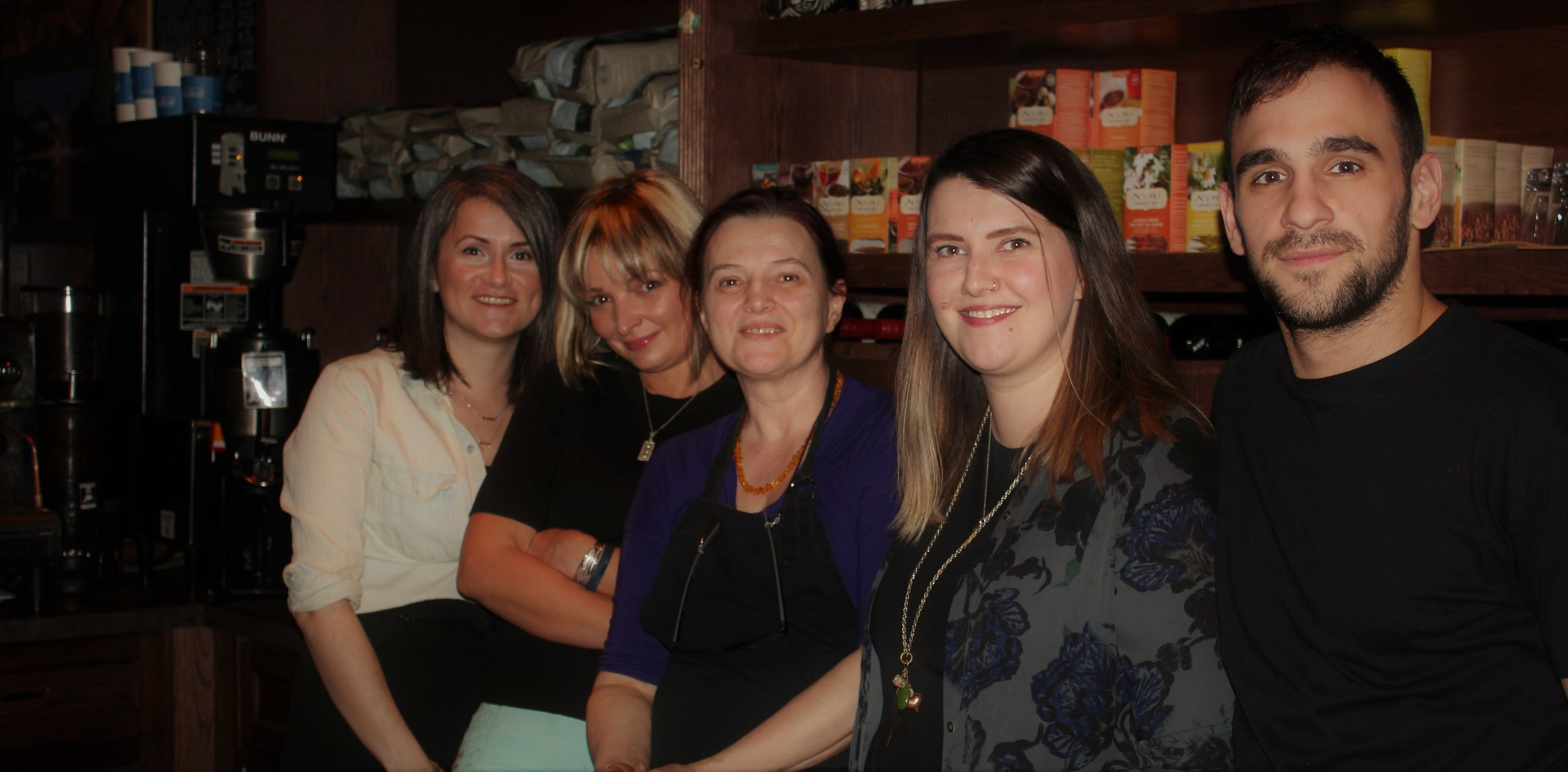 Lozena Dukic (middle) with her staff on the night of the show. She has owned and operated the local community cafe, Coffee Cats, for 17 years.