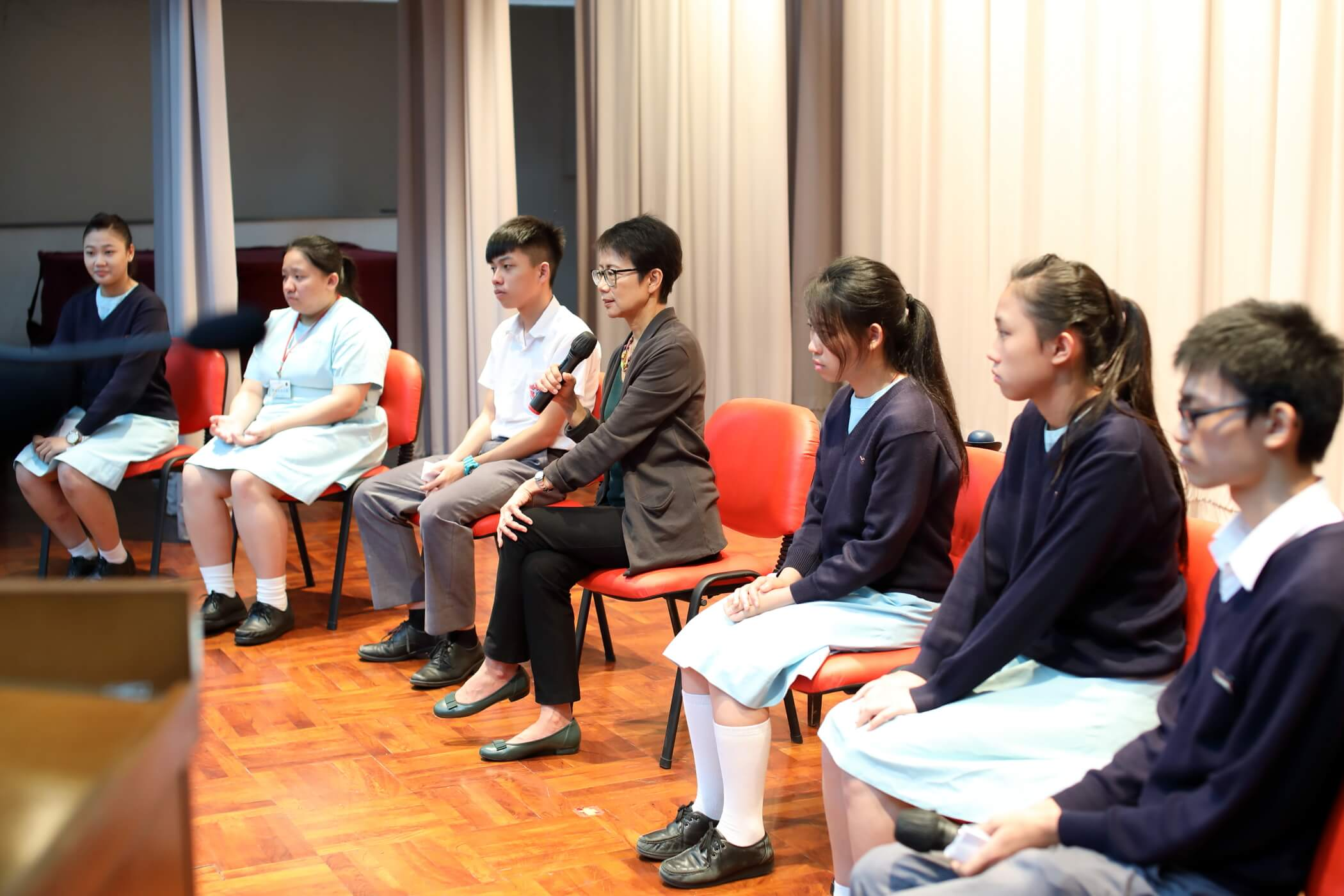 Christine Loh giving speech to students during her visit at Pui Shing Secondary School