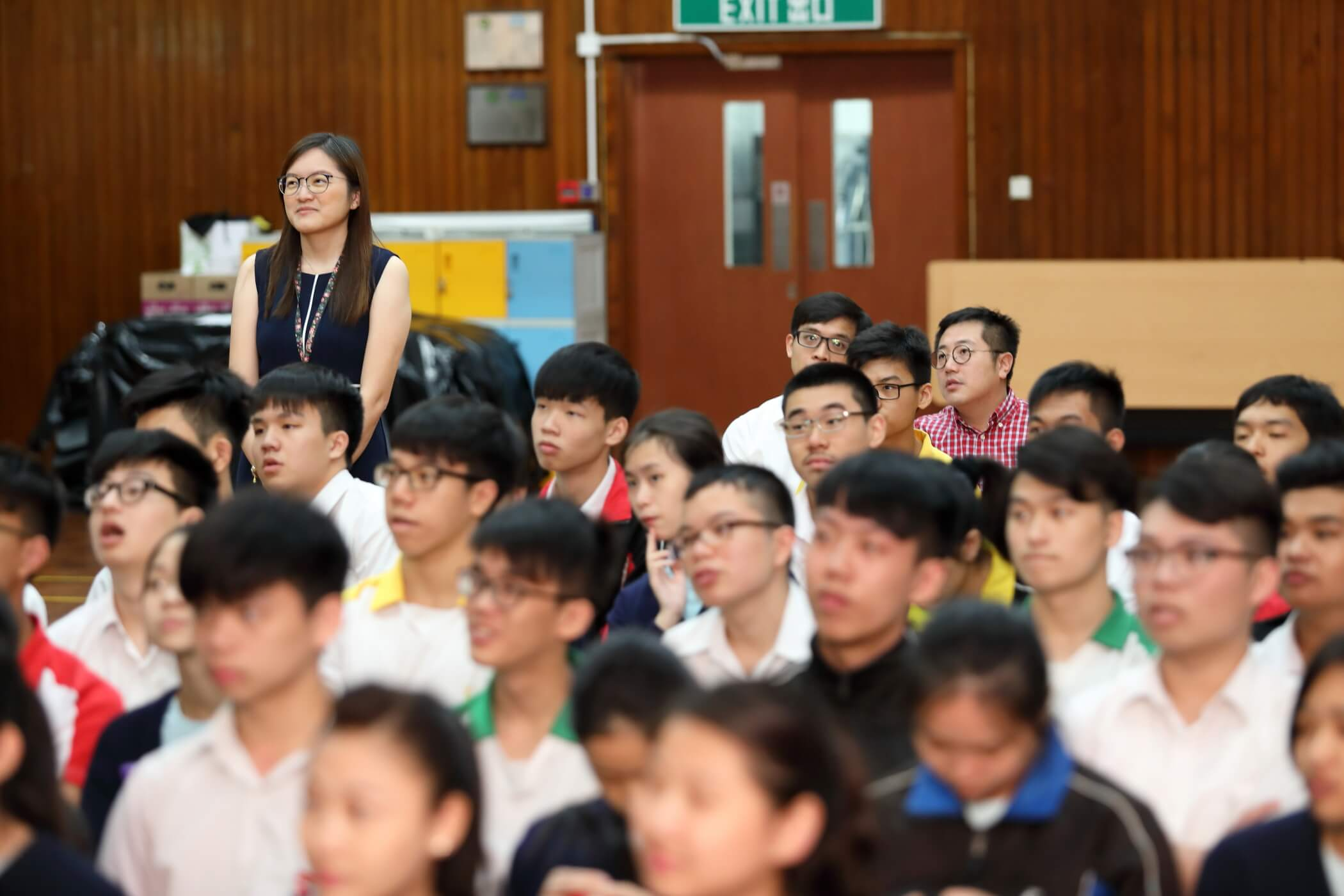 The students listen with attention to Christine Loh