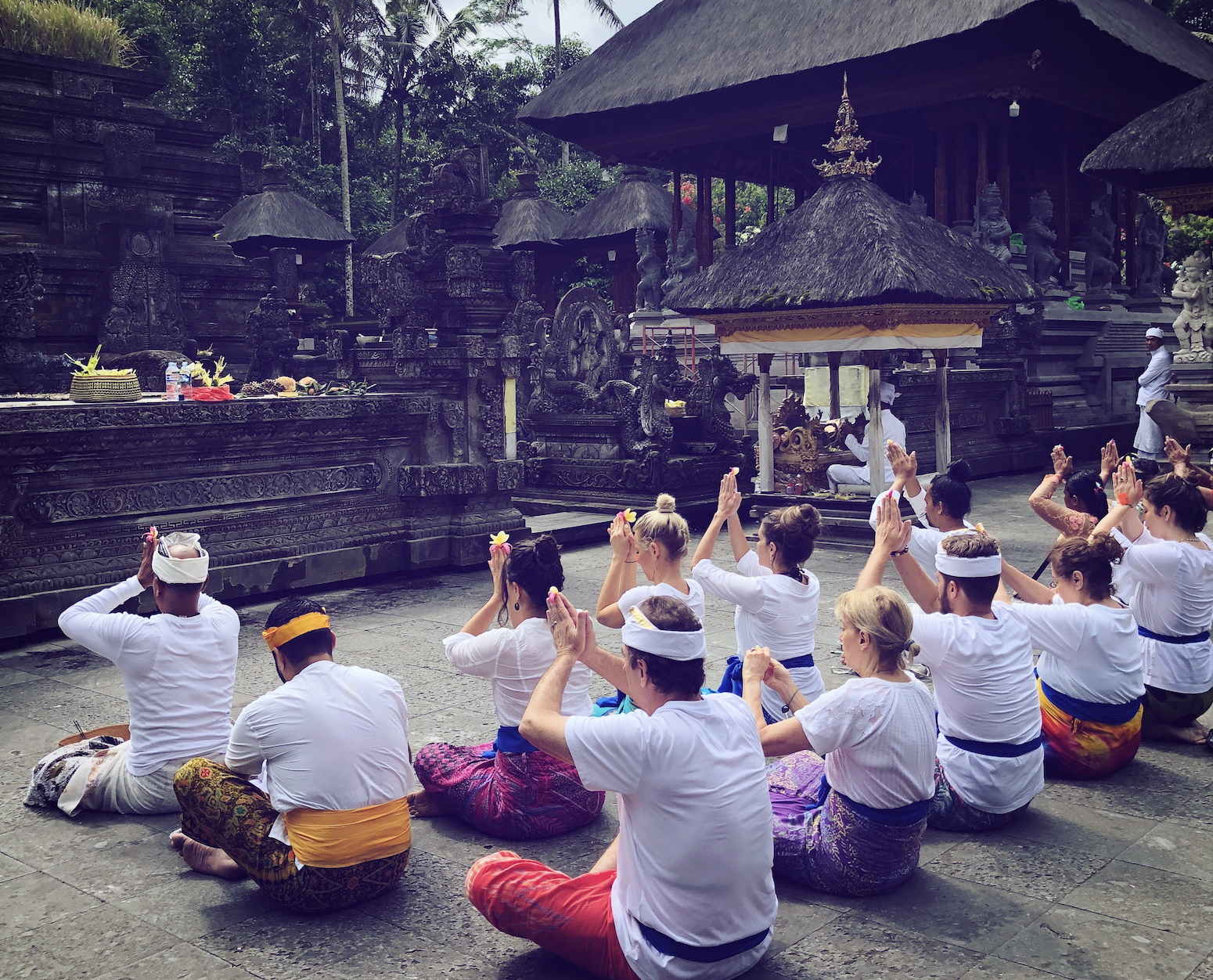 Our amazing Bali guides, Gede and Yanta, lead us through a traditional Balinese ceremony. -