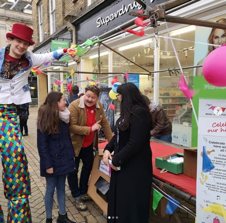 Writing fast on a poetry takeaway to celebrate the UK high street, in Stamford spring 2019