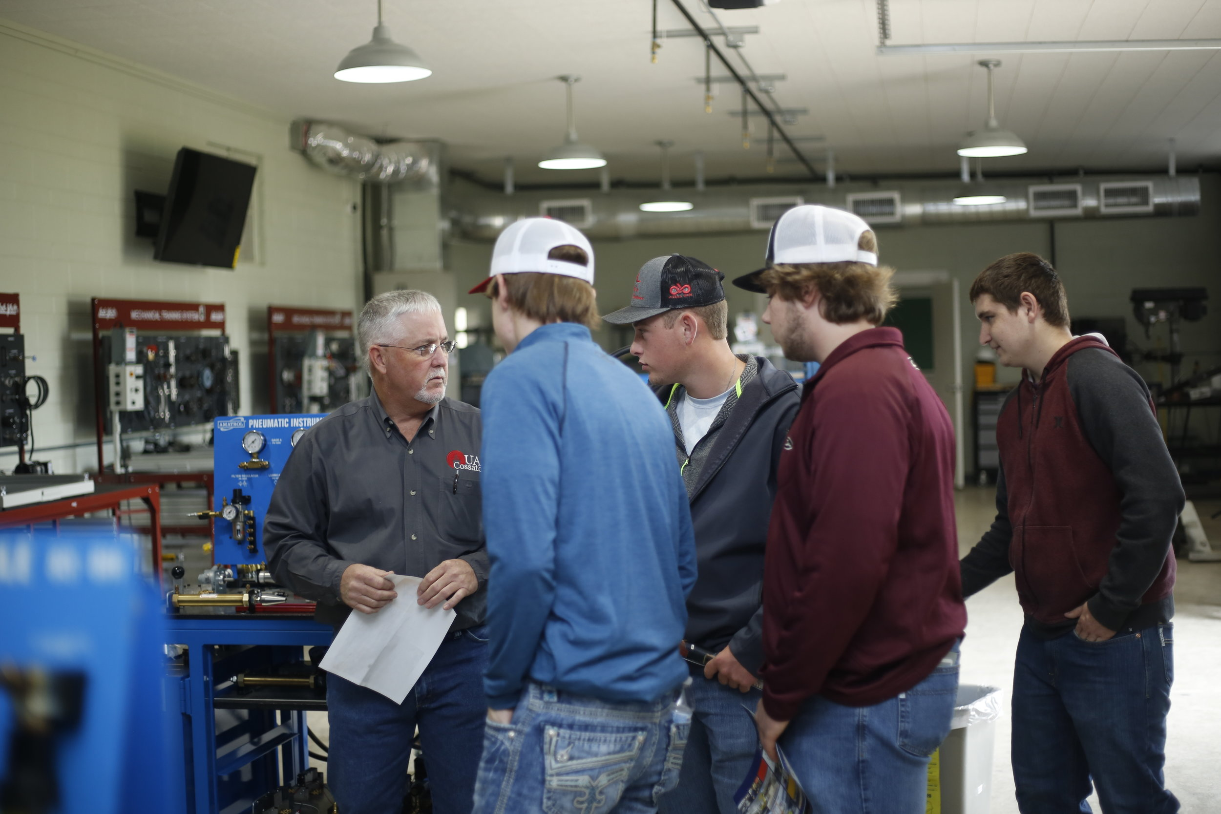 University of Arkansas Cossatot Industrial Technology Instructor Scott Surber discusses industrial maintenance and electricity training modules with high school students.