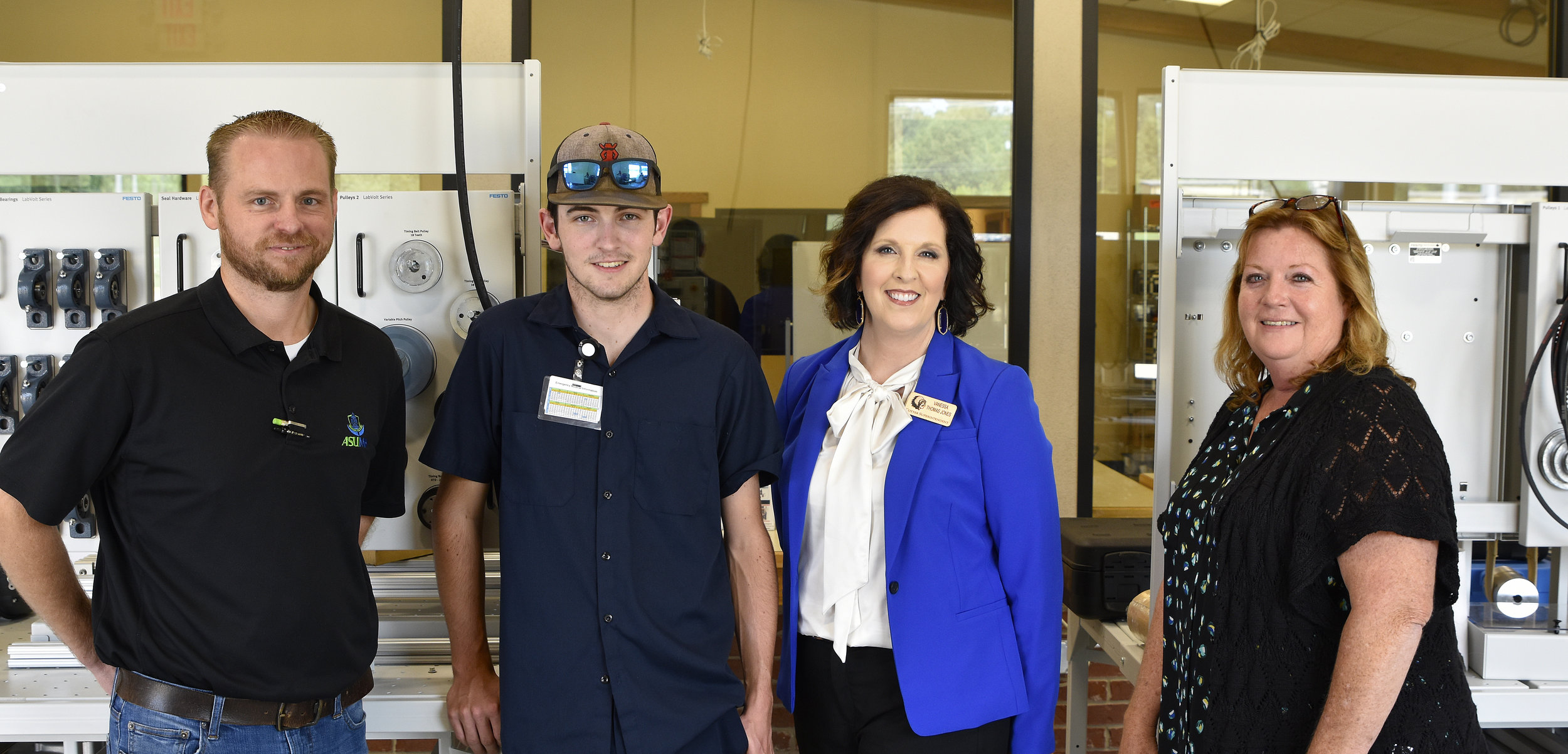 Pictured from left are Nathan Lueck, director of the ASUMH Secondary Tech Center; Jesse Hutchinson; Vanessa Thomas Jones, Cotter Superintendent; and Janel Cotter, director of workforce development for ASUMH.