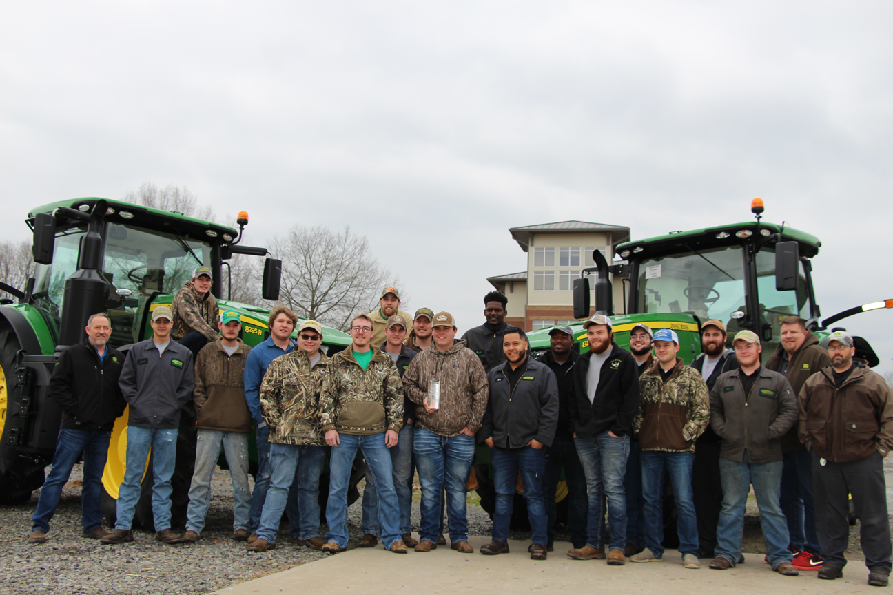 """CUTLINE: ASU-Beebe's John Deere Agriculture Technology program recently won the 2018 """"College of Tomorrow"""" Award from John Deere. Pictured, from left: Shawn Taillon, department head and instructor, Jacob Ashcraft, Tre Maxwell, Jacob Kayser, Luke Skipper, Norman Collins, AJ McClung, Hunter James, Kyle Nance, Braeden Beliew, Craig McCoy, Kiylin Taylor, Eric Vargas, Kenvonte Jackson, Daniel Noble, Nickolus Kearns, Cody Stroud, Cole Brumley, Alex Hughes, instructor Stephen Yokley, and Michael Bonecutter."""