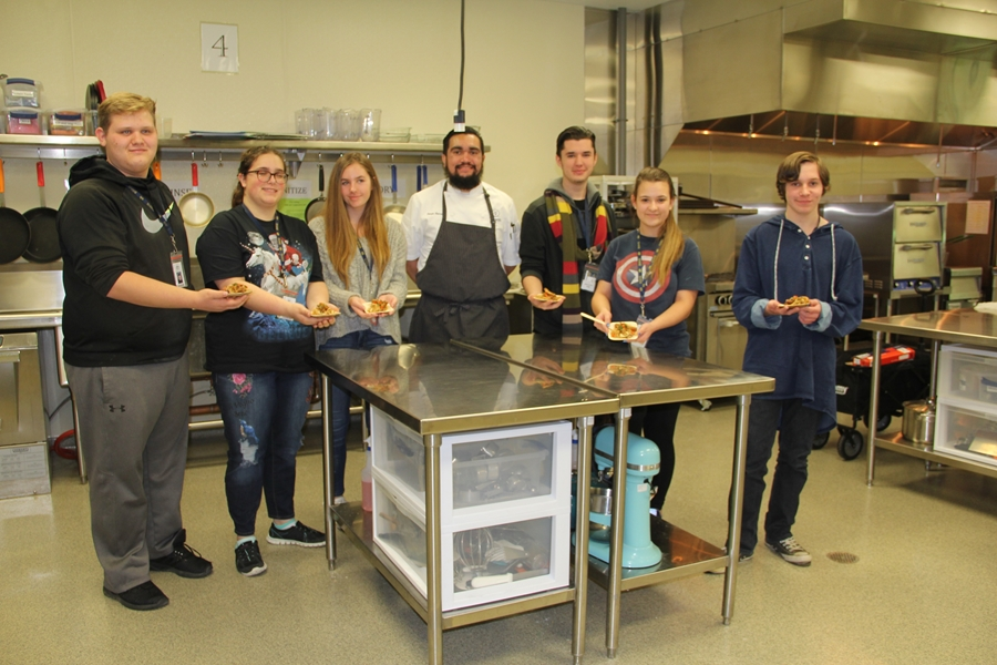 Food and culinary sciences student Sergio Herrera (center) spoke to culinary students at Bentonville West High School about how food, science, chemistry, sensory and safety all come together in the food industry.  Photo by Rosa Buescher