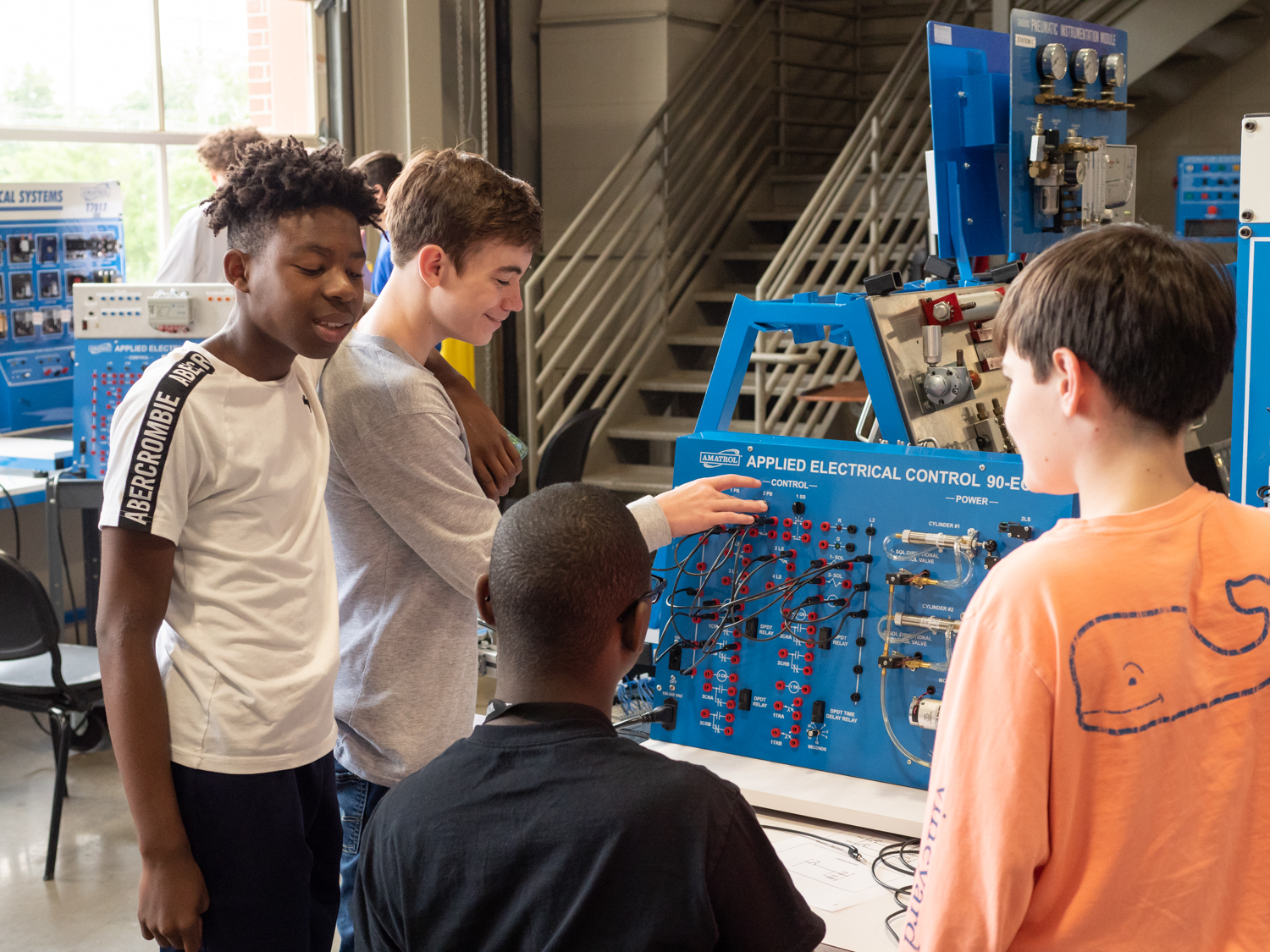Arkansas State University Mid South Mechatronic Career Camp participants engage in hands-on activities to learn basic electricity and pneumatic skills that are used in numerous manufacturing processes.
