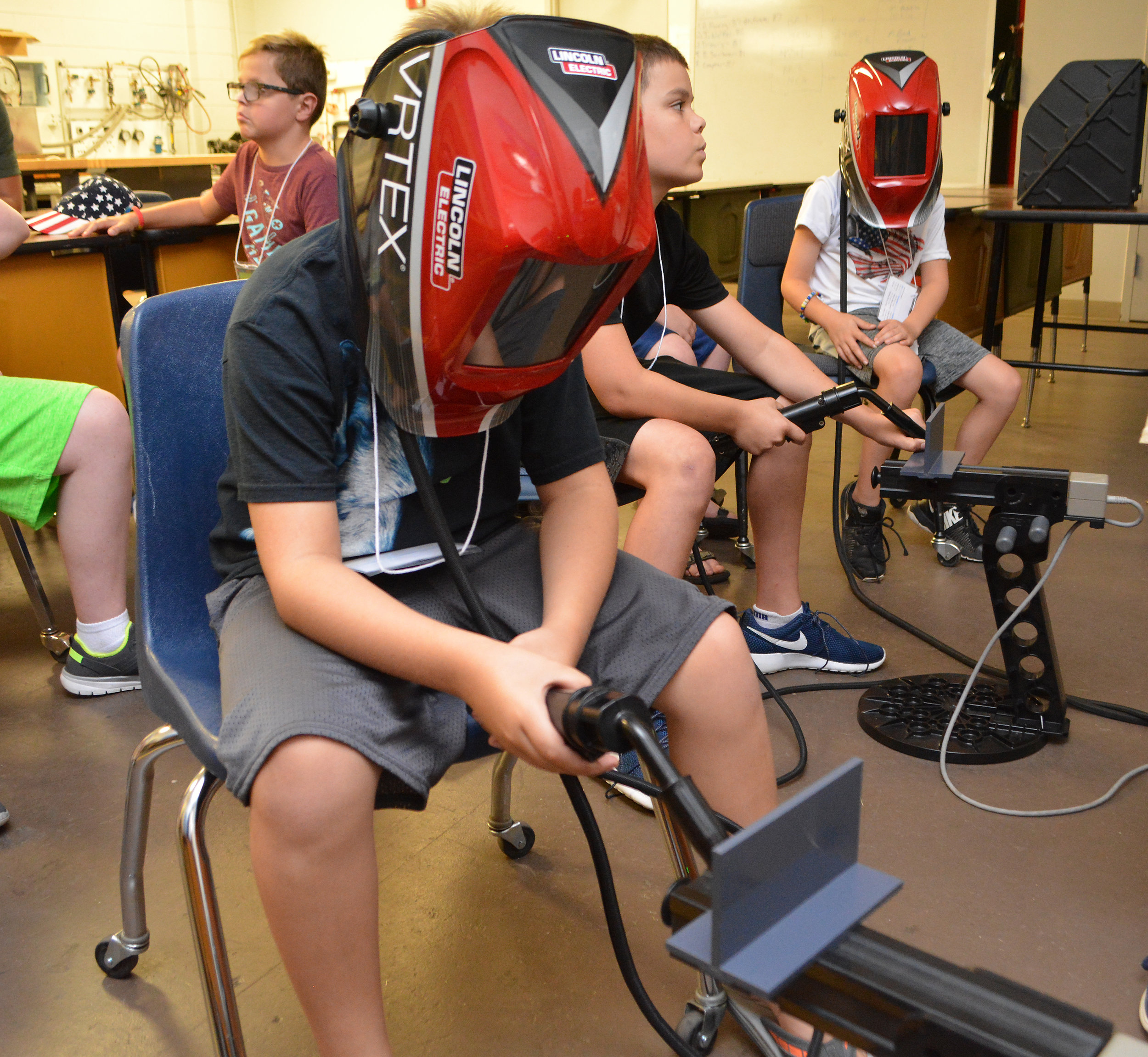 University of Arkansas Community College Batesville Inside Engineering Camp participants weld on welding simulators.