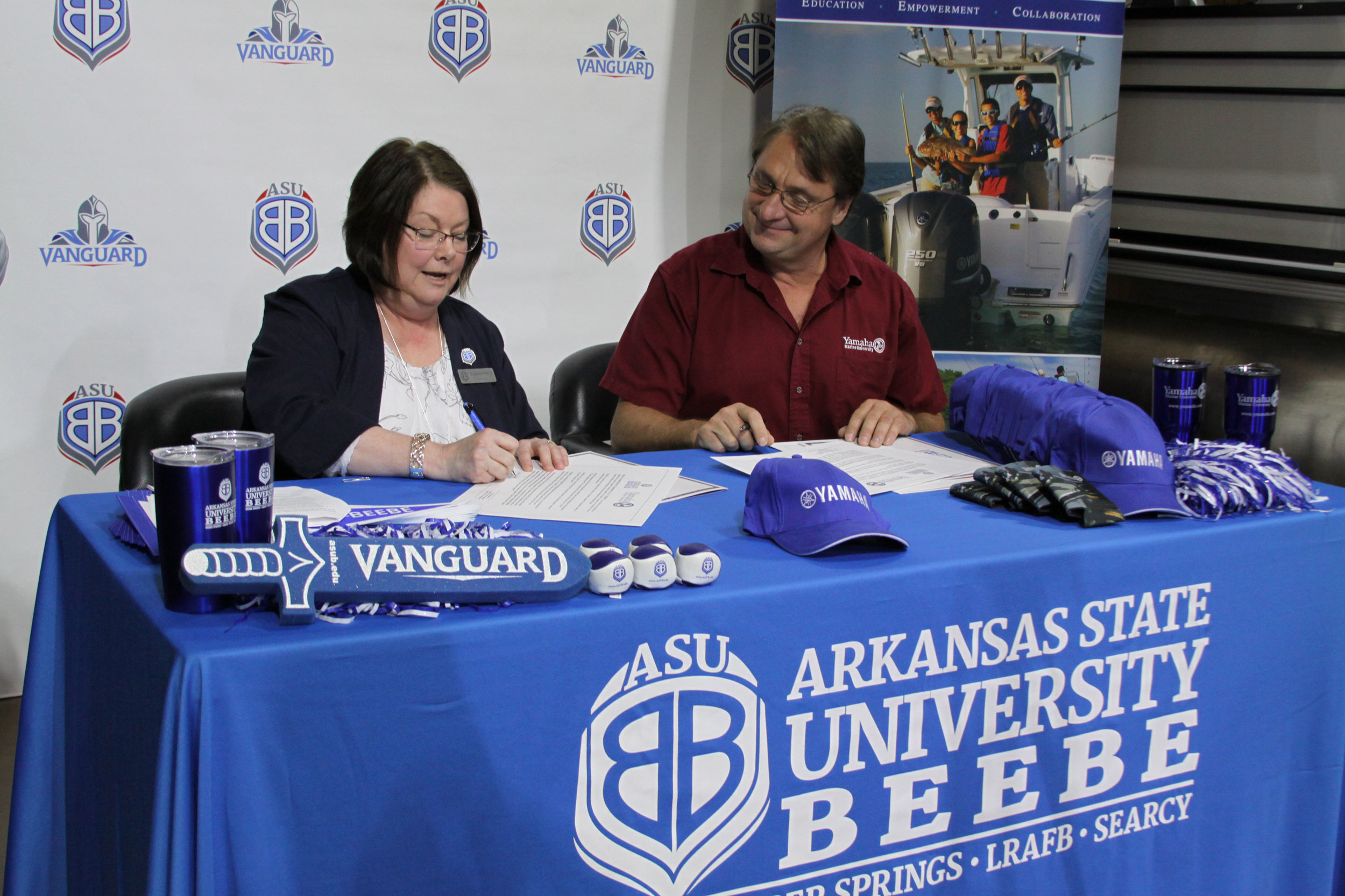 Dr. Jennifer Methvin, chancellor of ASU-Beebe and Steve Maciosek, regional service manager for Yamaha Motor Corporation, U.S.A. sign the agreement establishing the Yamaha Outboard Service Technician training program at ASU-Beebe' s Searcy campus on Wednesday, July 17, 2019. The program will create a career track to become a Yamaha certified Marine Master Service Technician.   (Photo courtesy ASU-Beebe)  .
