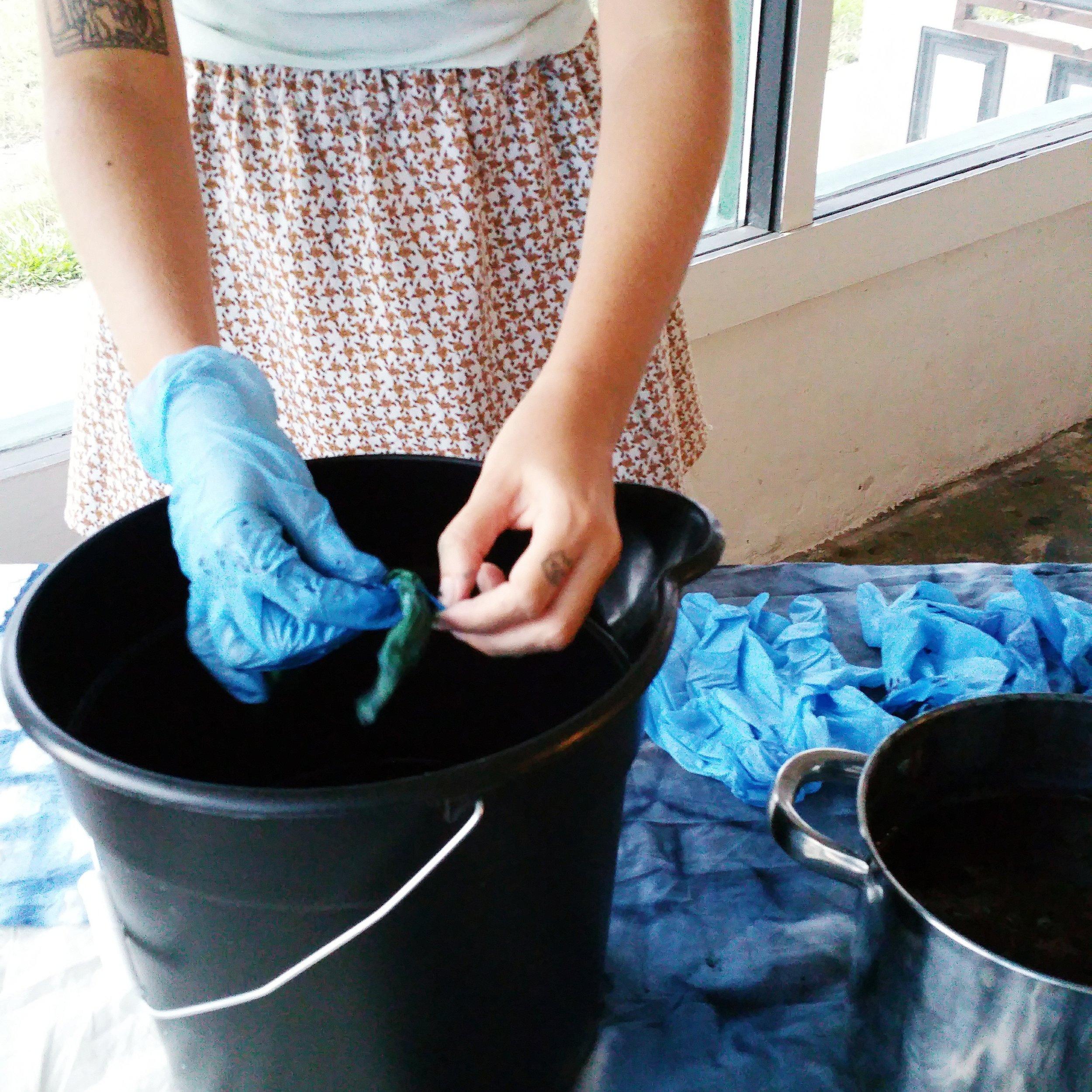 student dyeing during  intro to indigo and shibori dyeing