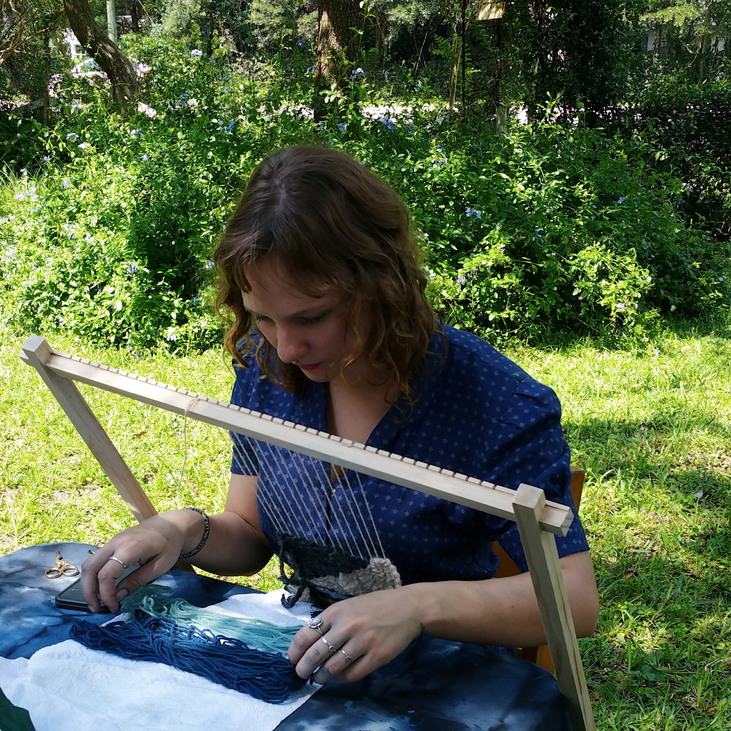 student weaving during  intro to tapestry weaving