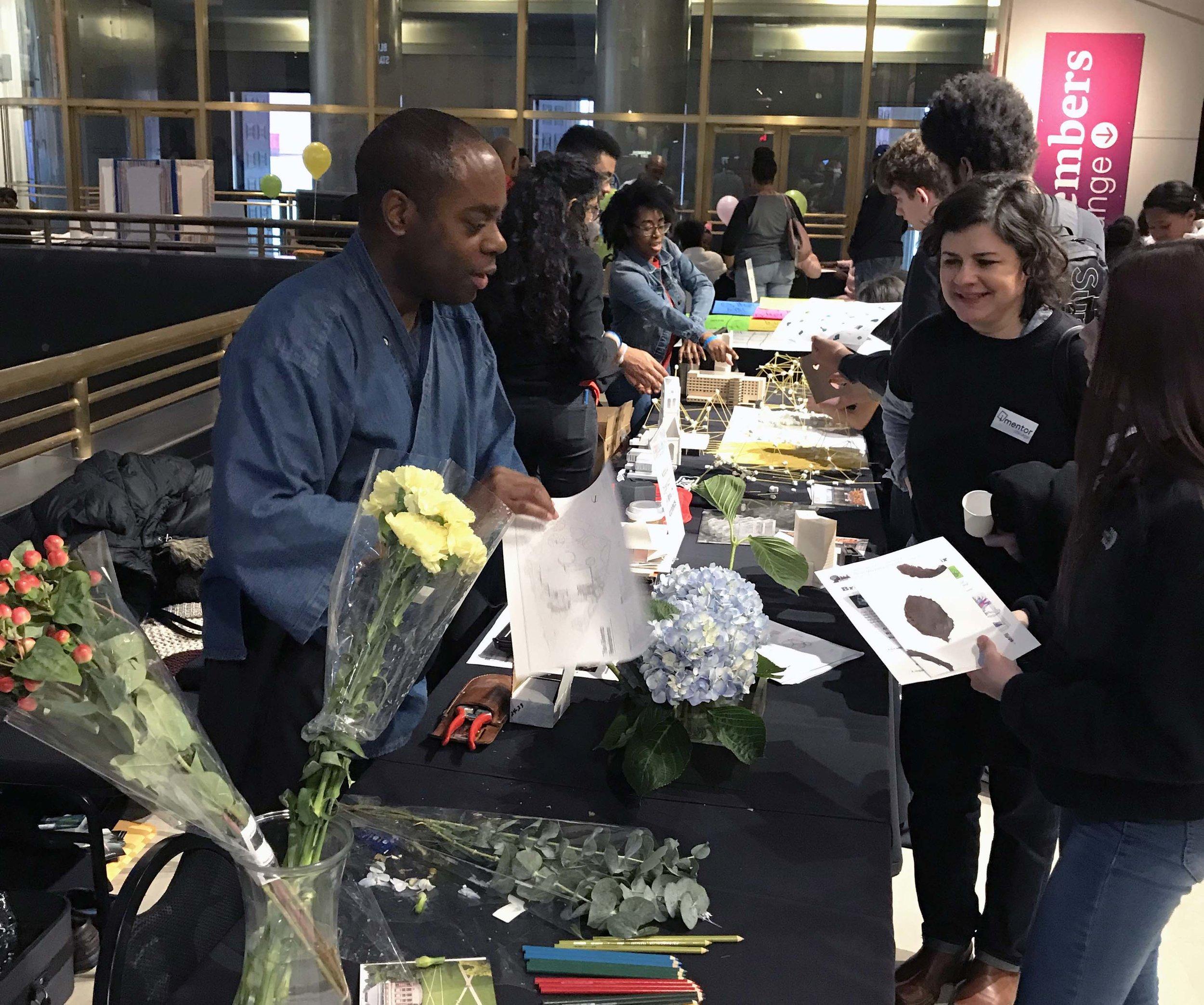Douglas Williams talking with visitors of Black Creativity Showcase 2019