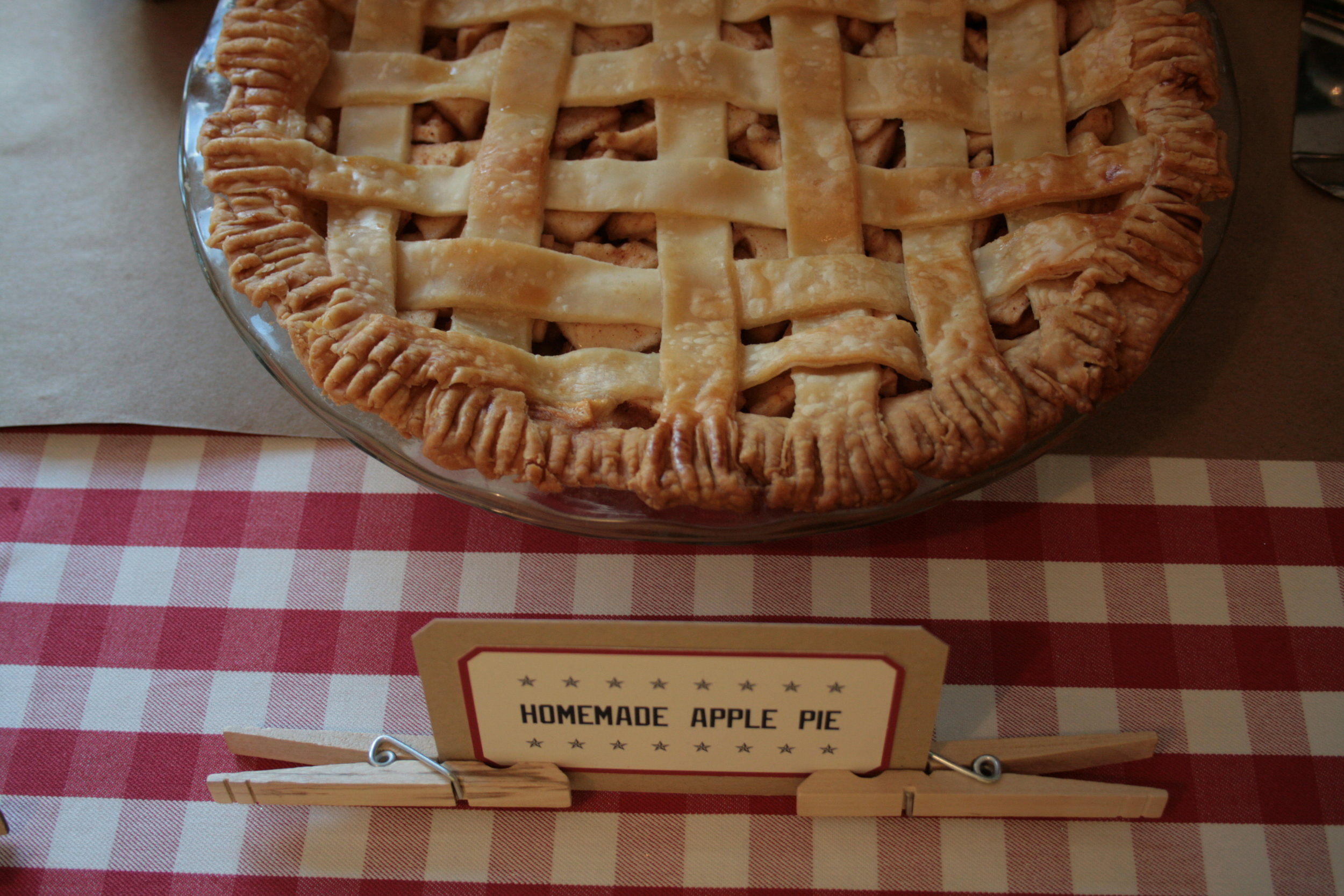 Jeff's mom made the pie. I designed and created the little signs and propped them up with clothespins