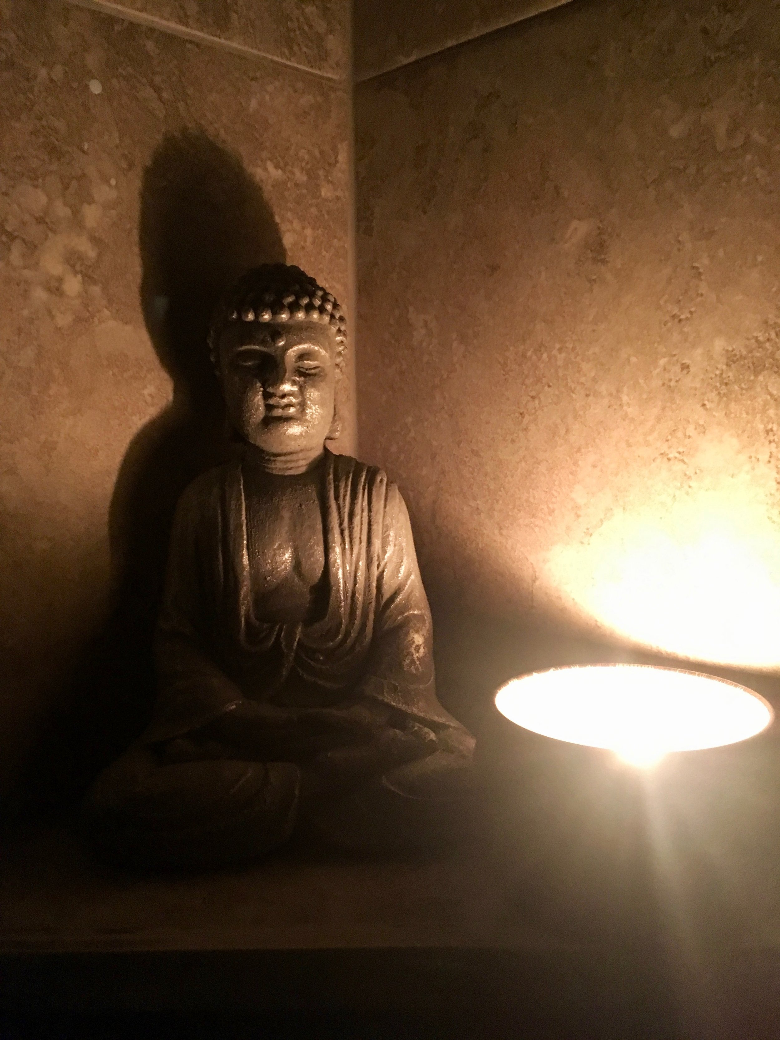 Buddha and a candle for a winning serenity shower!