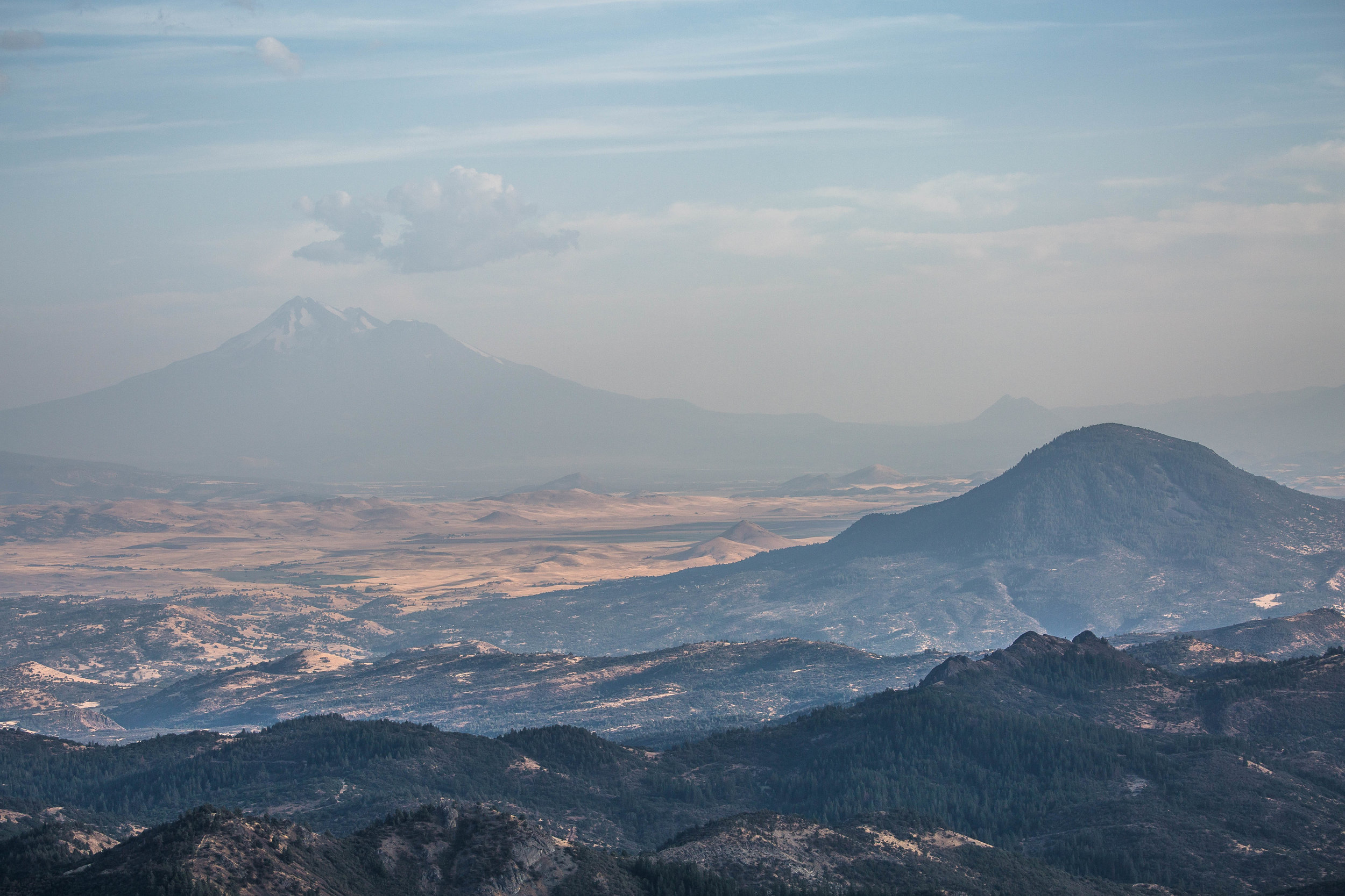 - California's Mt. Shasta can be seen from various peaks within Cascade-Siskiyou National Monument, despite the smoky haze from nearby forest fires.