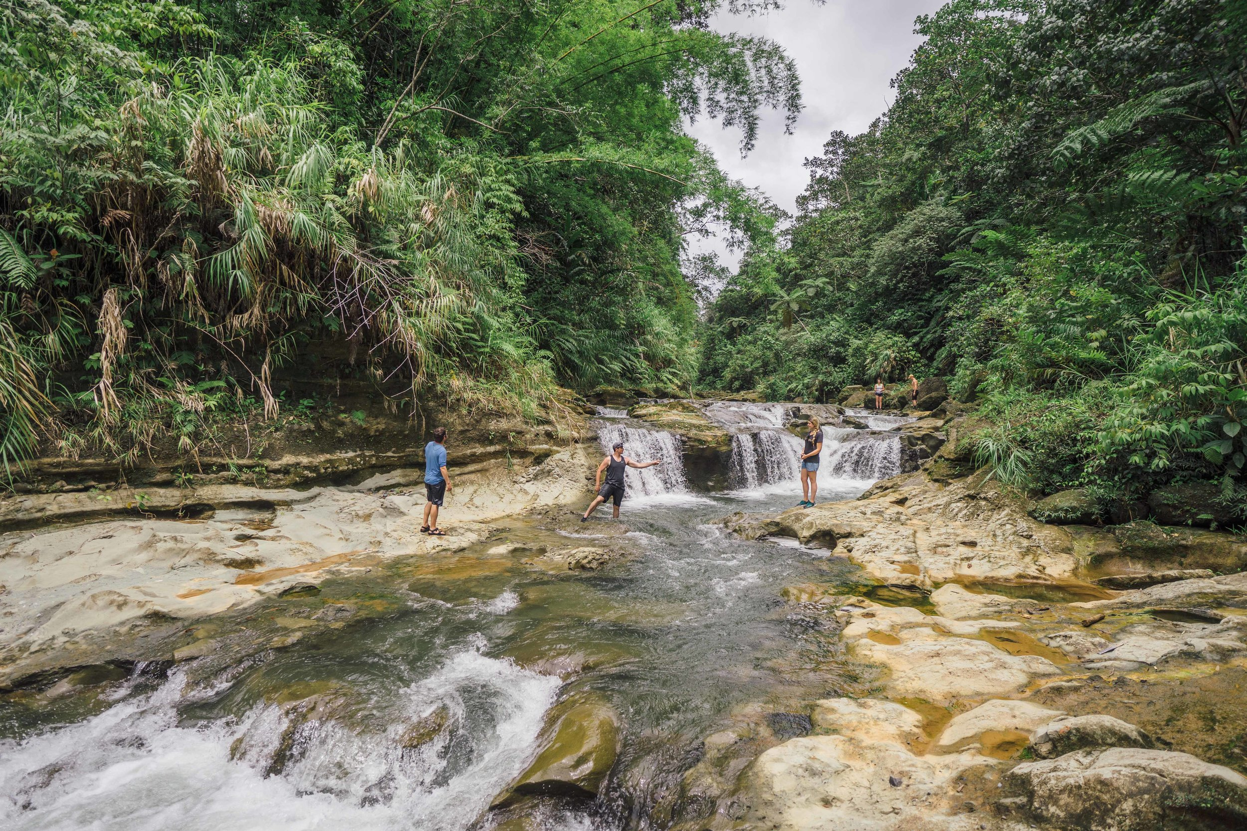 - Exploring one of the side rivers with natural swimming pools while lunch by the Navua River was being set up by our guides.