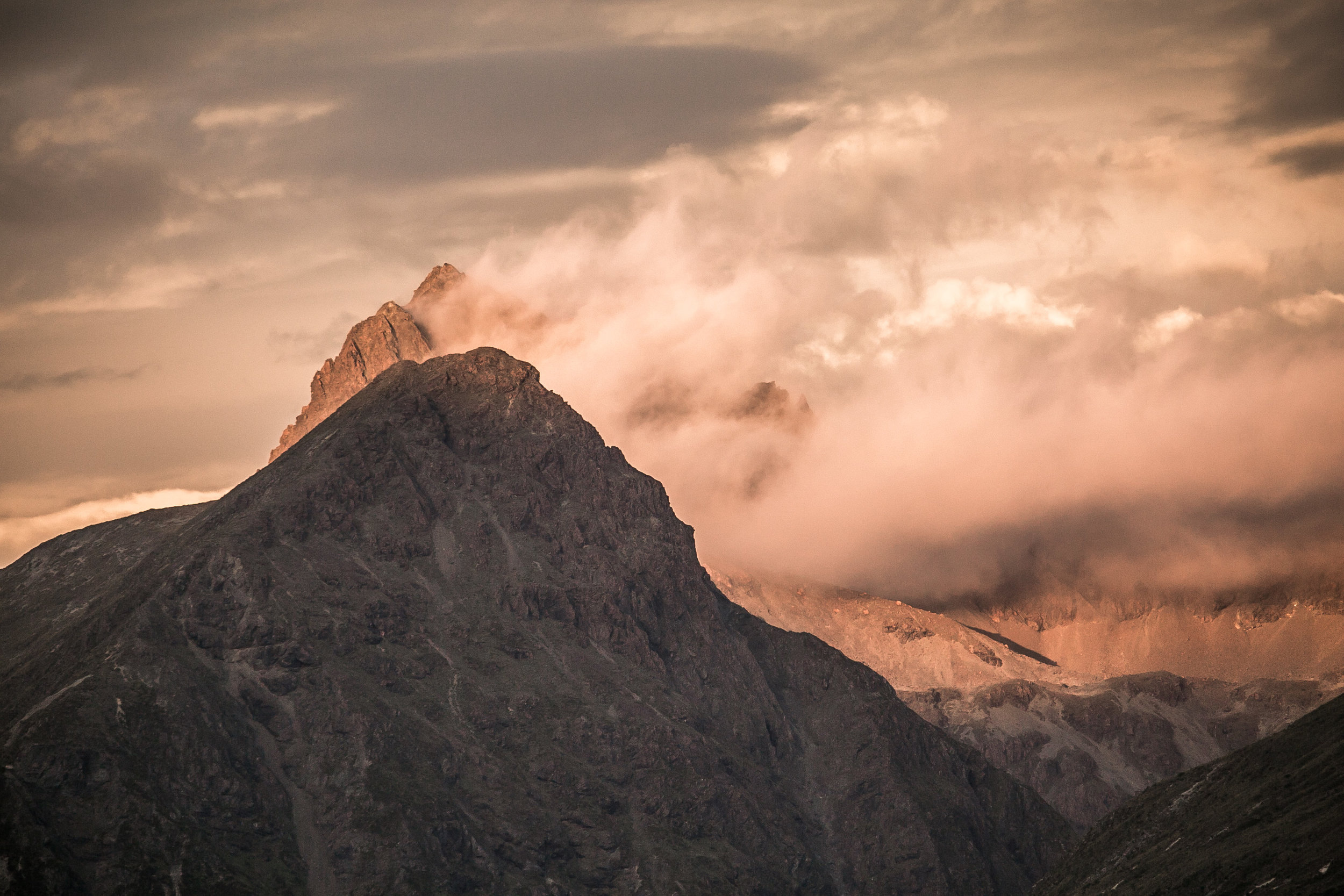 """VIew from the """"mavora walkway"""" section of the trail - Soft evening sunlight settling on New Zealand's rugged mountains on the South Island."""