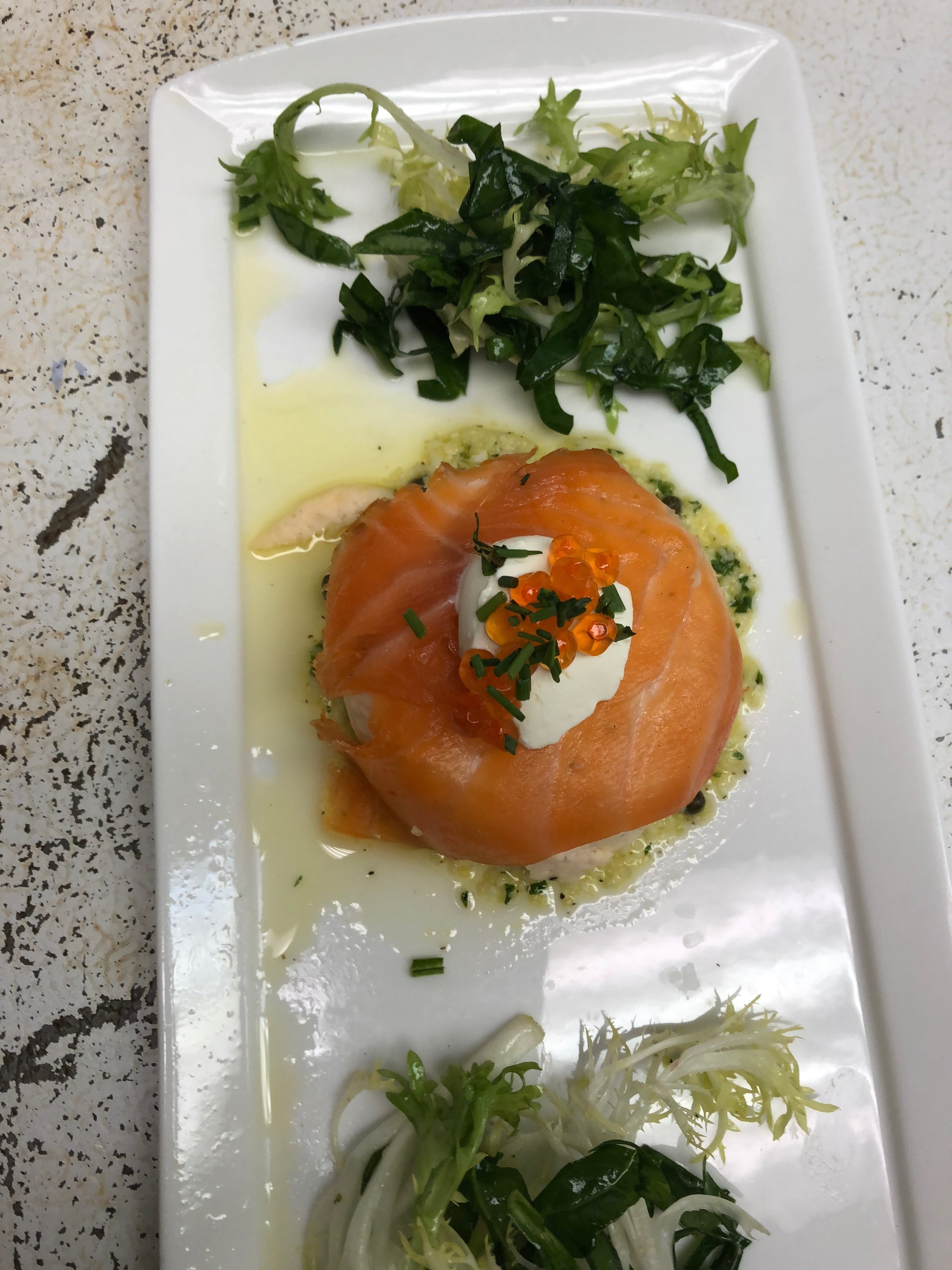 Smoked salmon and frisée spinach salad in hazelnut dressing.