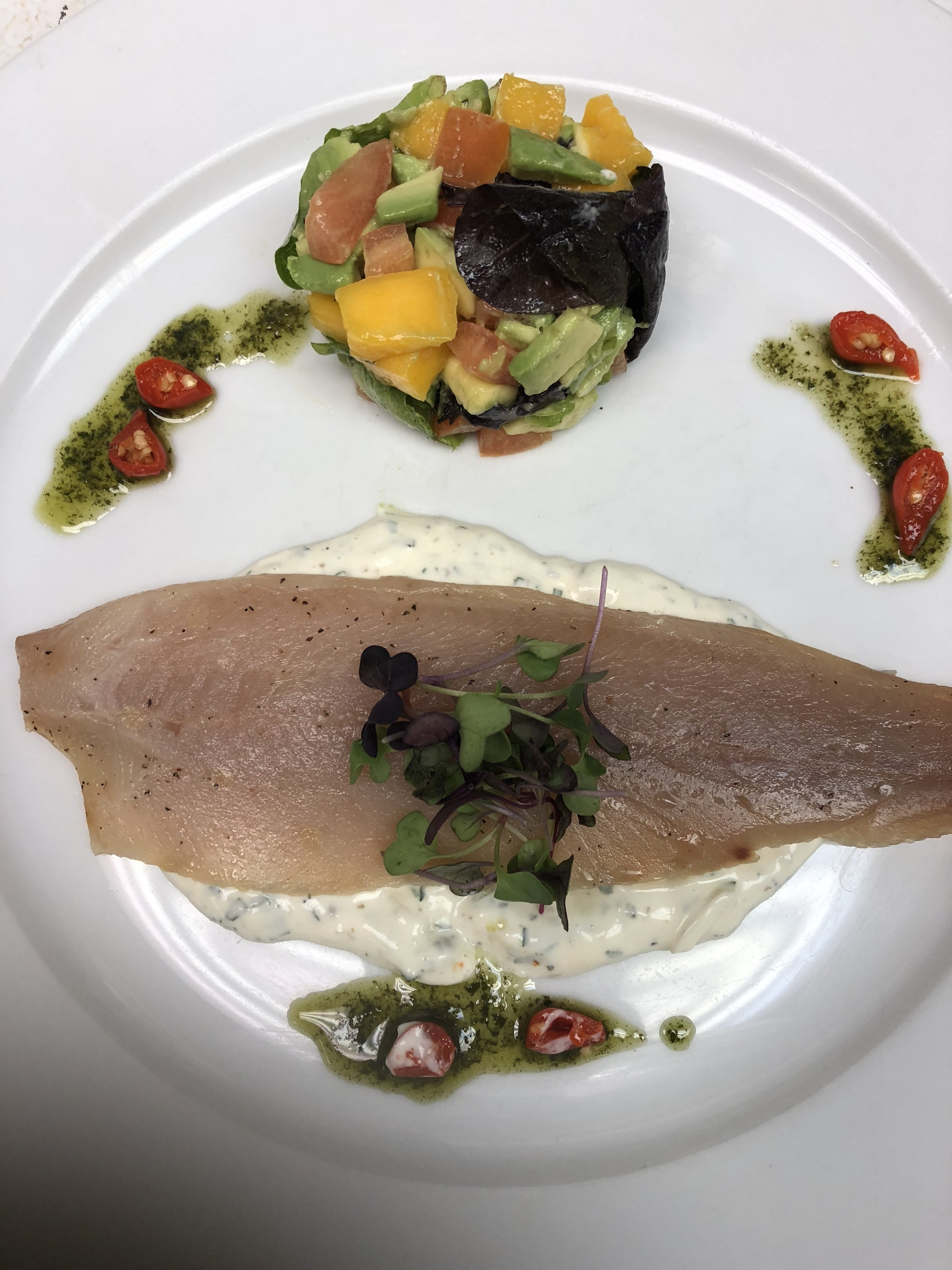 Smoked trout with avocado mango salad and tartar sauce.