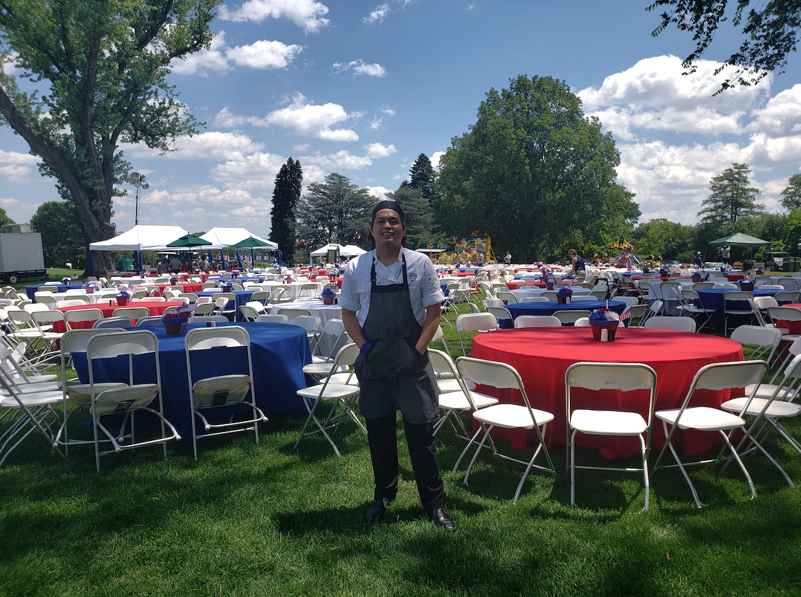 Photo was taken last June 30, 2019 the celebration of July 4th Independence Day in Baltimore Country Club here in Maryland. America themed tables and chairs was arranged by Food and Beverage Team. The culinary team prepared for 2,500 pax American Food like Fried Chicken, Burgers, Hotdogs, Corn, Mac and Cheese, Corn, the famous crabe cake of Maryland, and many more. Working in BCC is fun a lot of people, culture and of course recipe to know that i can share when I go back in my home country. This is the memory of my summer and July 4th in America. Many more to experience here in America in this one year internship. Thank you WWCE!  Keith Joaquin Enriquez / APT / Baltimore, MD