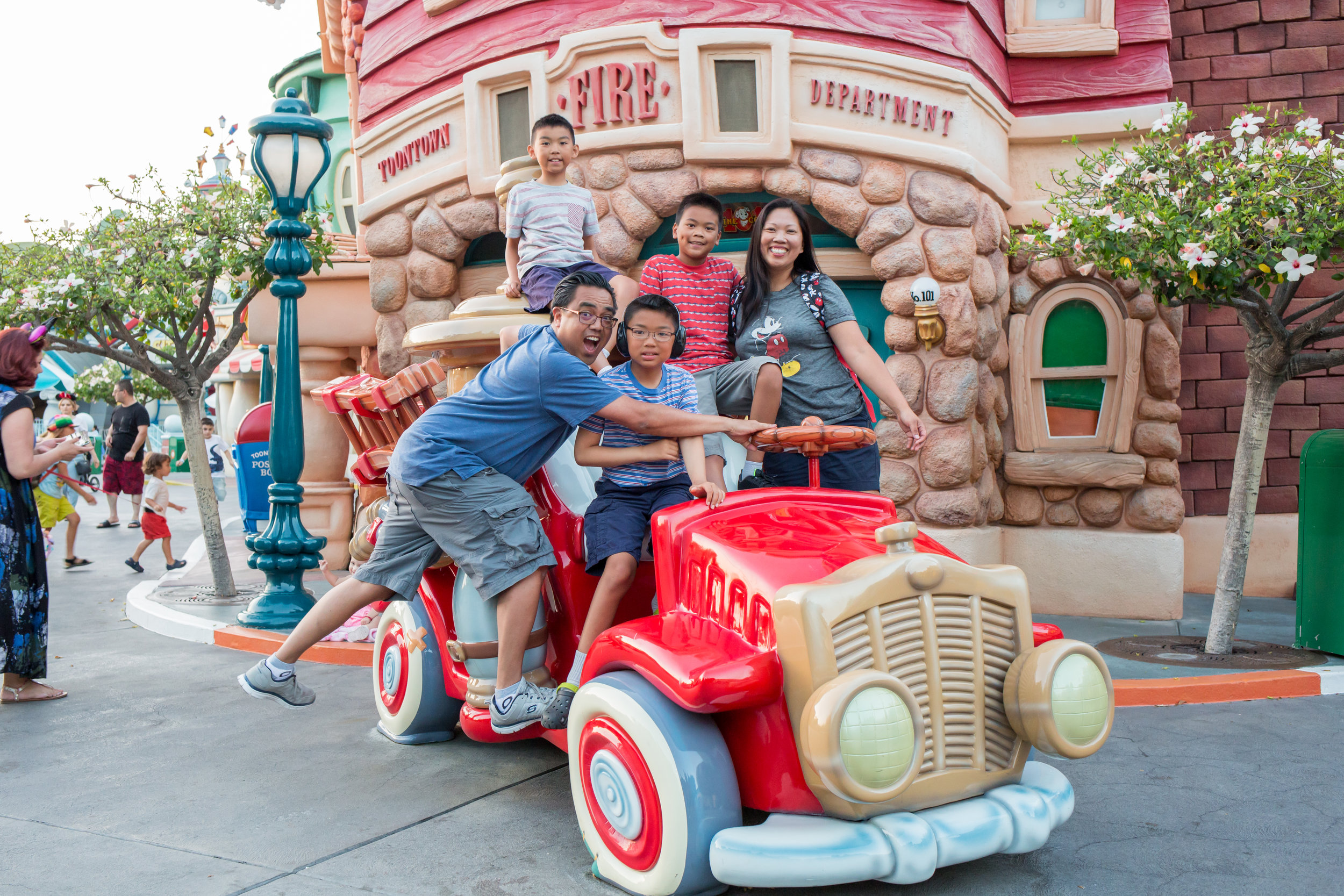 family of five on toon car at Disney CA Adventure Park
