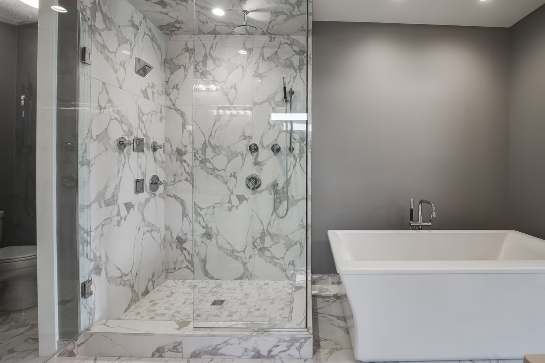 This marble ensuite is a stunner. The workmanship is immaculate and the designer choices work together effortlessly. I love the functionality of tile base in a bathroom, it is easy to clean and looks clean for longer than wood or MDF options.