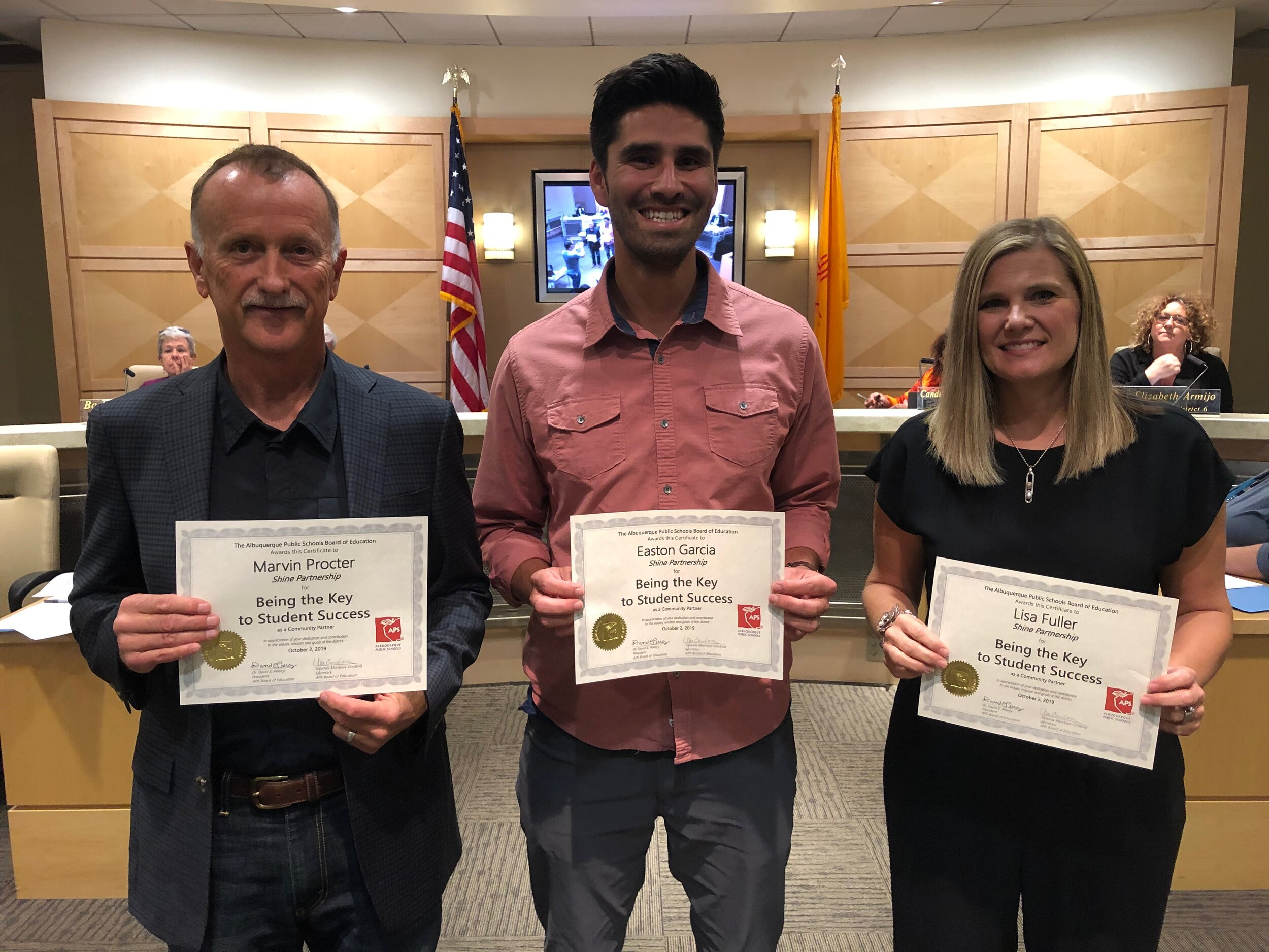 Shine Board of Directors receive recognition from APS School Board. (Pictured: Marvin Procter, Easton Garcia, Lisa Fuller)