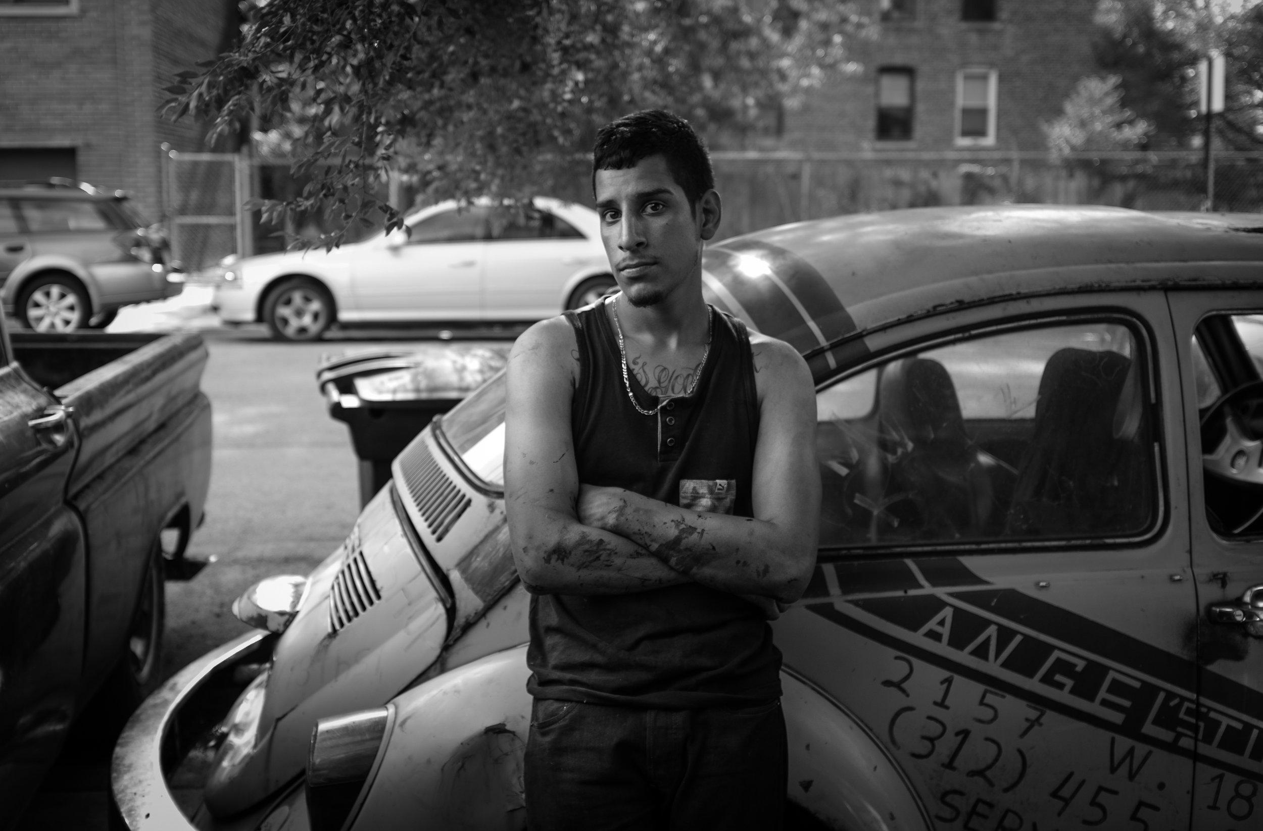 Jose Salgado, a longtime Pilsen resident and son of Angel Salgado, taking his break at Angel's Tire Shop, a staple of the community in 2016.