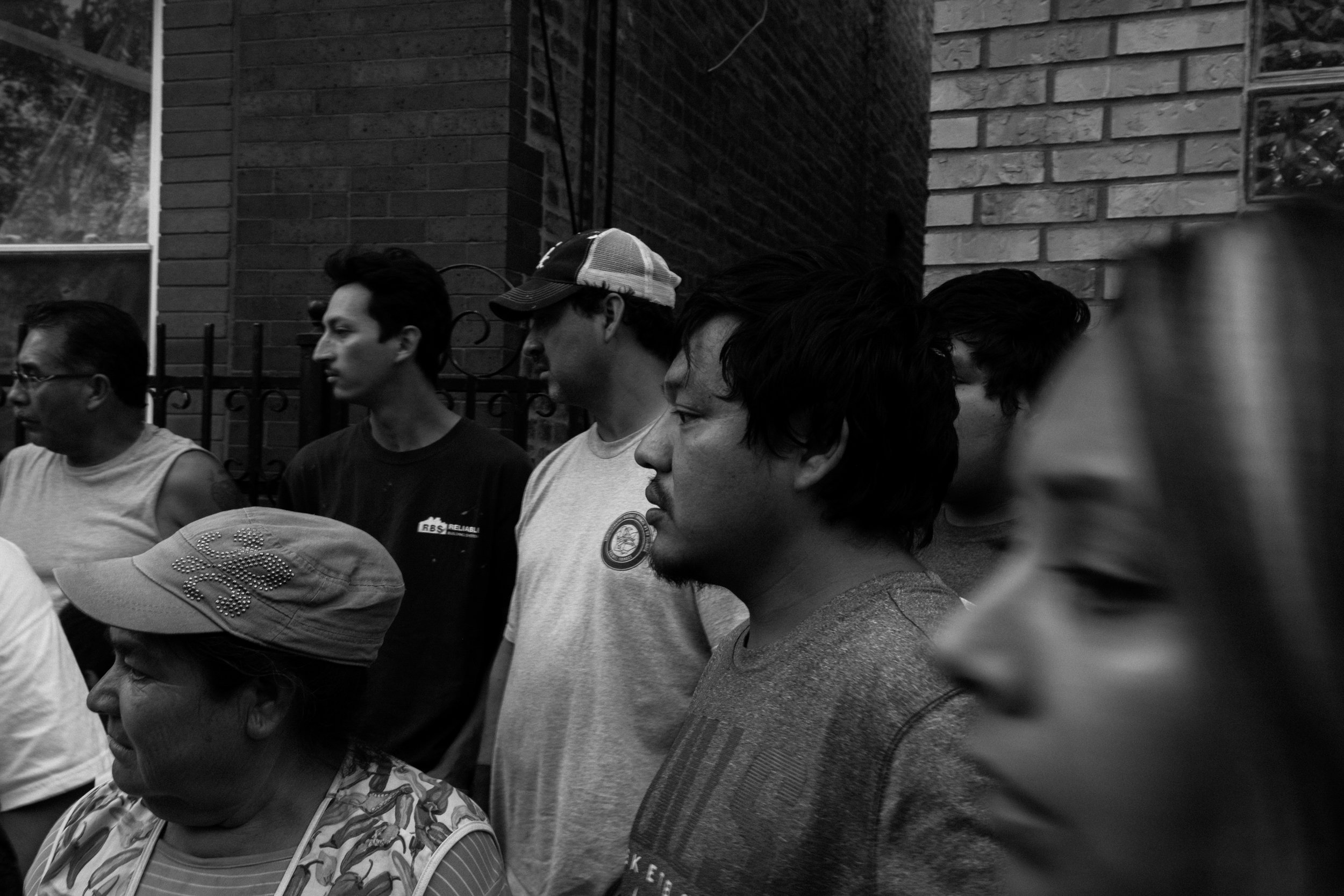 Pilsen residents gathered outside a popular pizza restaurant as Jason Patlen, a victim of a gun-related crime, bled on the ground in 2017.