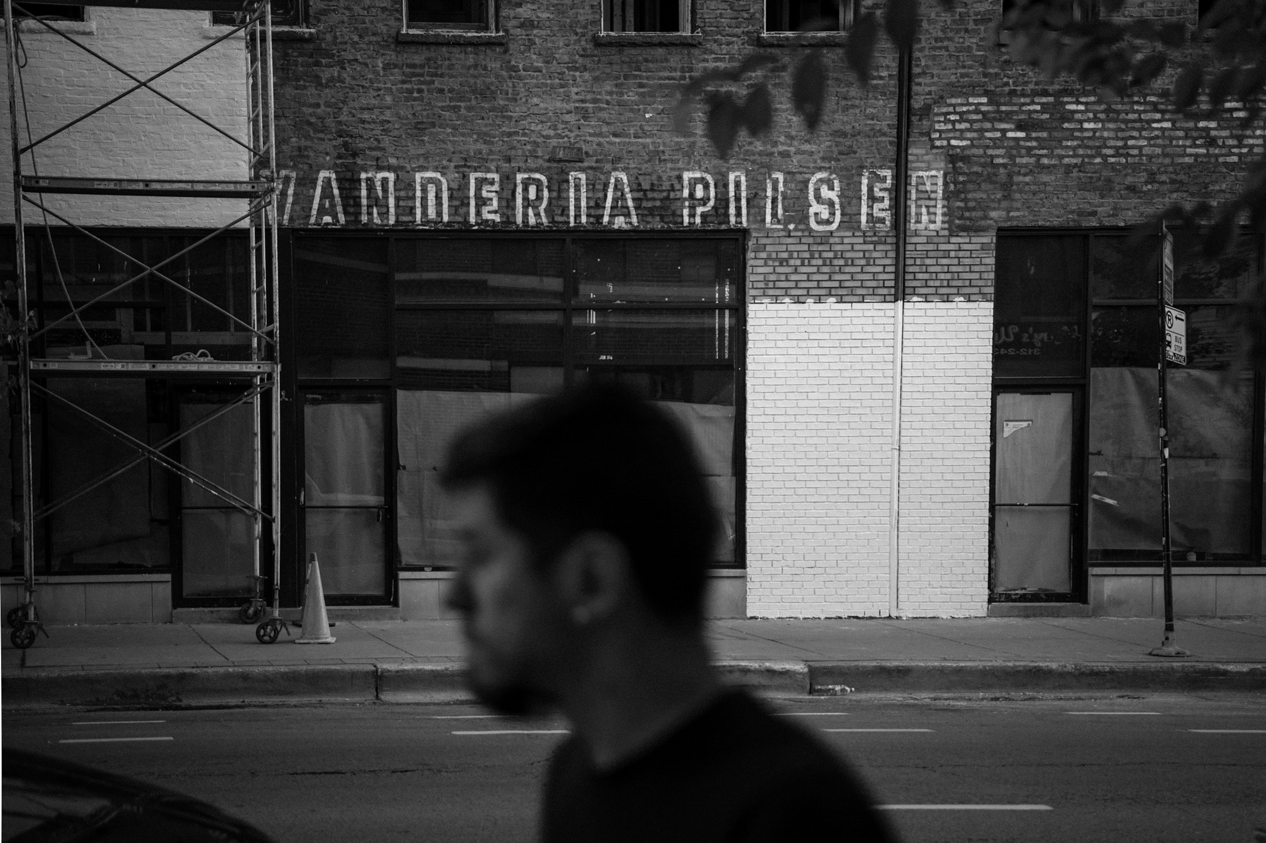 La Vanderia Pilsen, a known local gathering is cover in white paint after the building sold to developers.