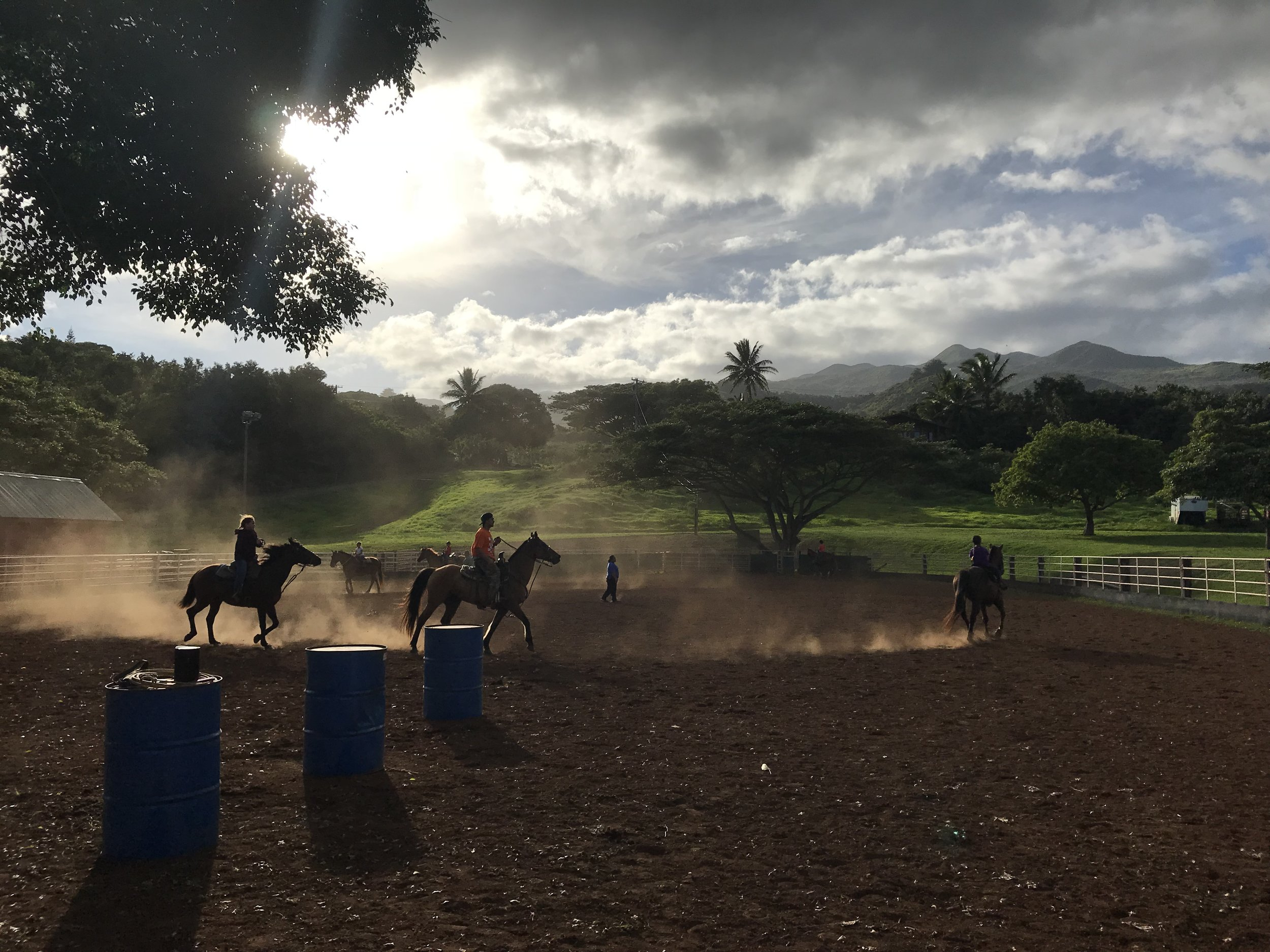Cowboys teaching the next generation how to rope at Hana Ranch.