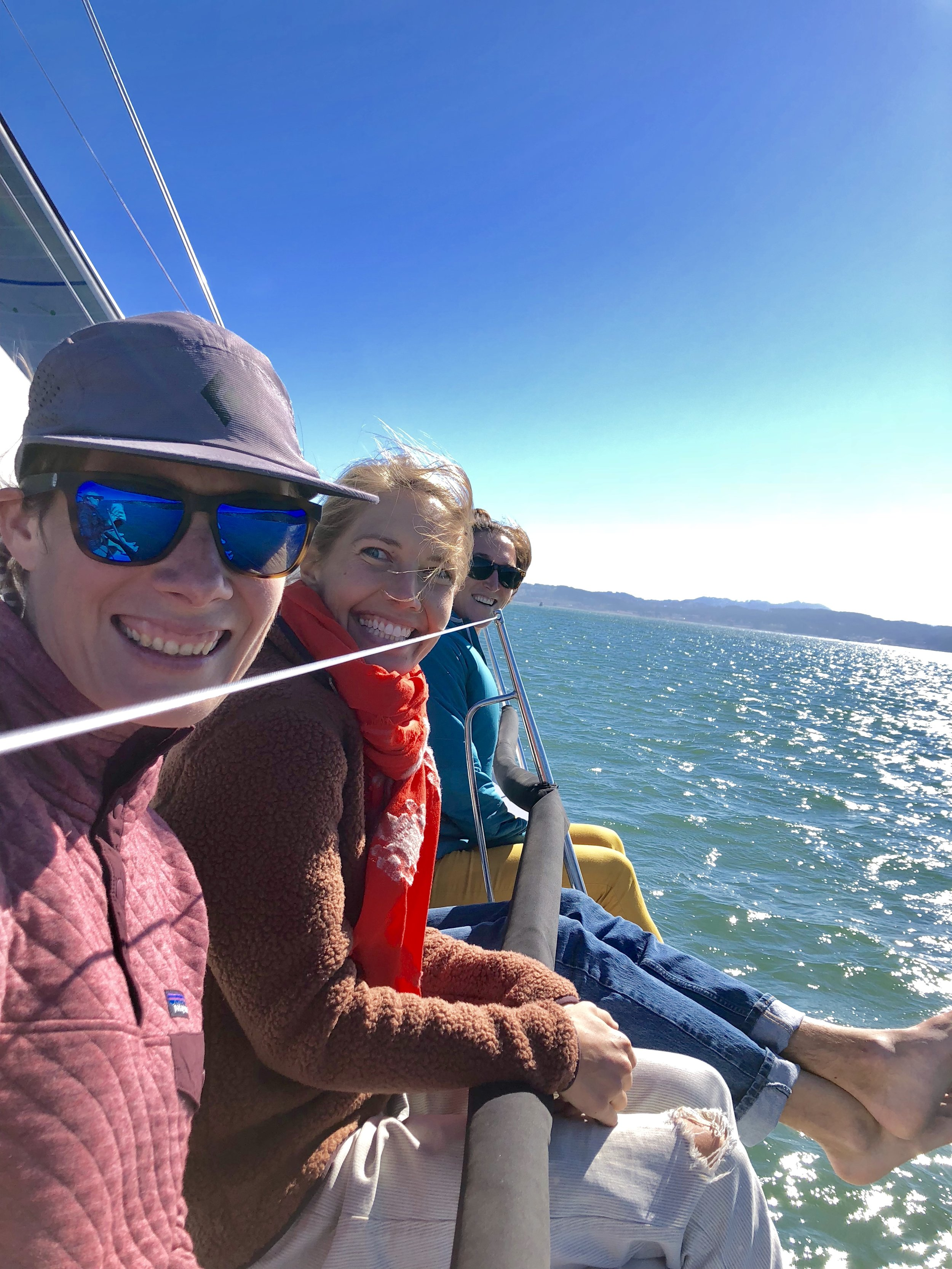 Meriwether, Kristen and Lilly sailing in the Bay.