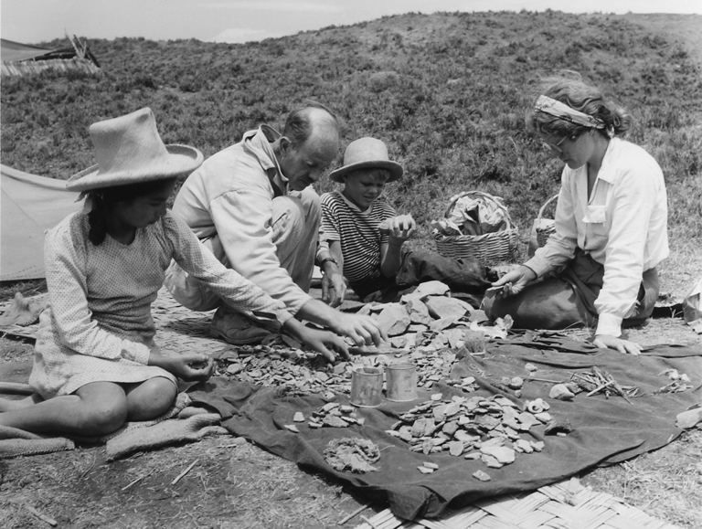 Elvira Sanchez, Junius Bird, Bob Bird, and Margaret (Peggy) Bird sorting material from sifters at Huaca Prieta, 1946-1947. Photo by John Collier
