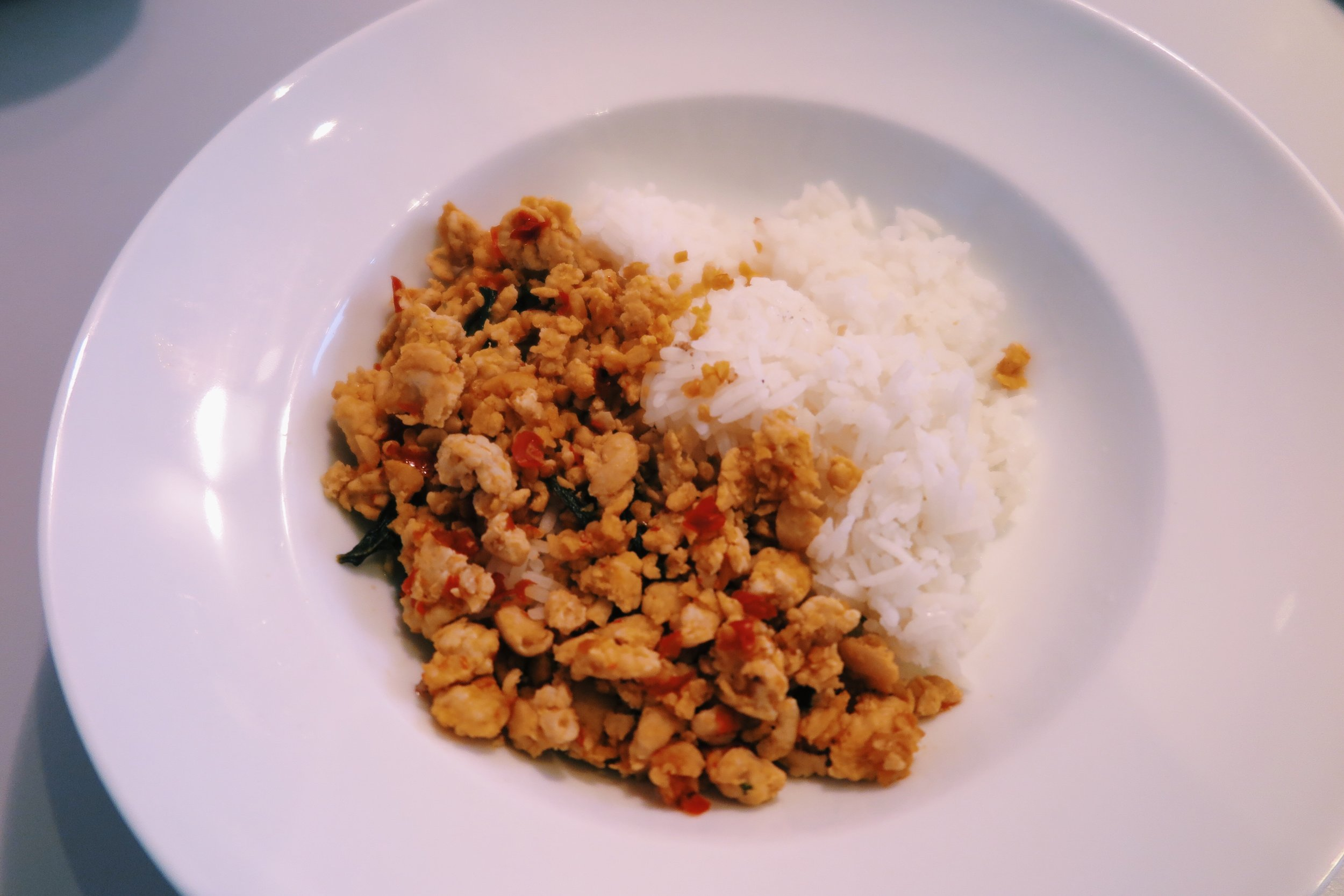 4.  Pad kra pao (spicy Thai chicken + basil) + rice