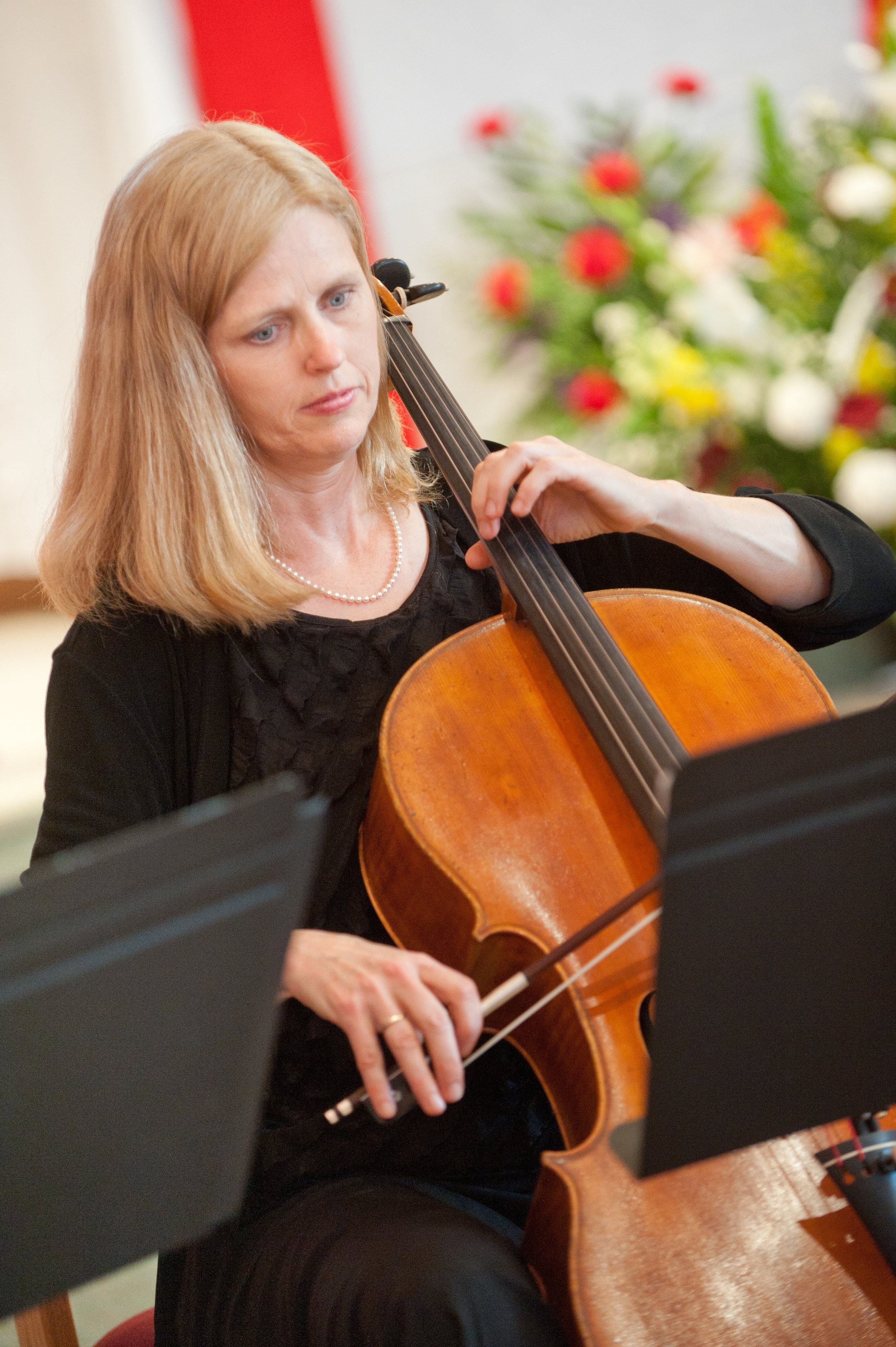 Kathy playing cello at a church event
