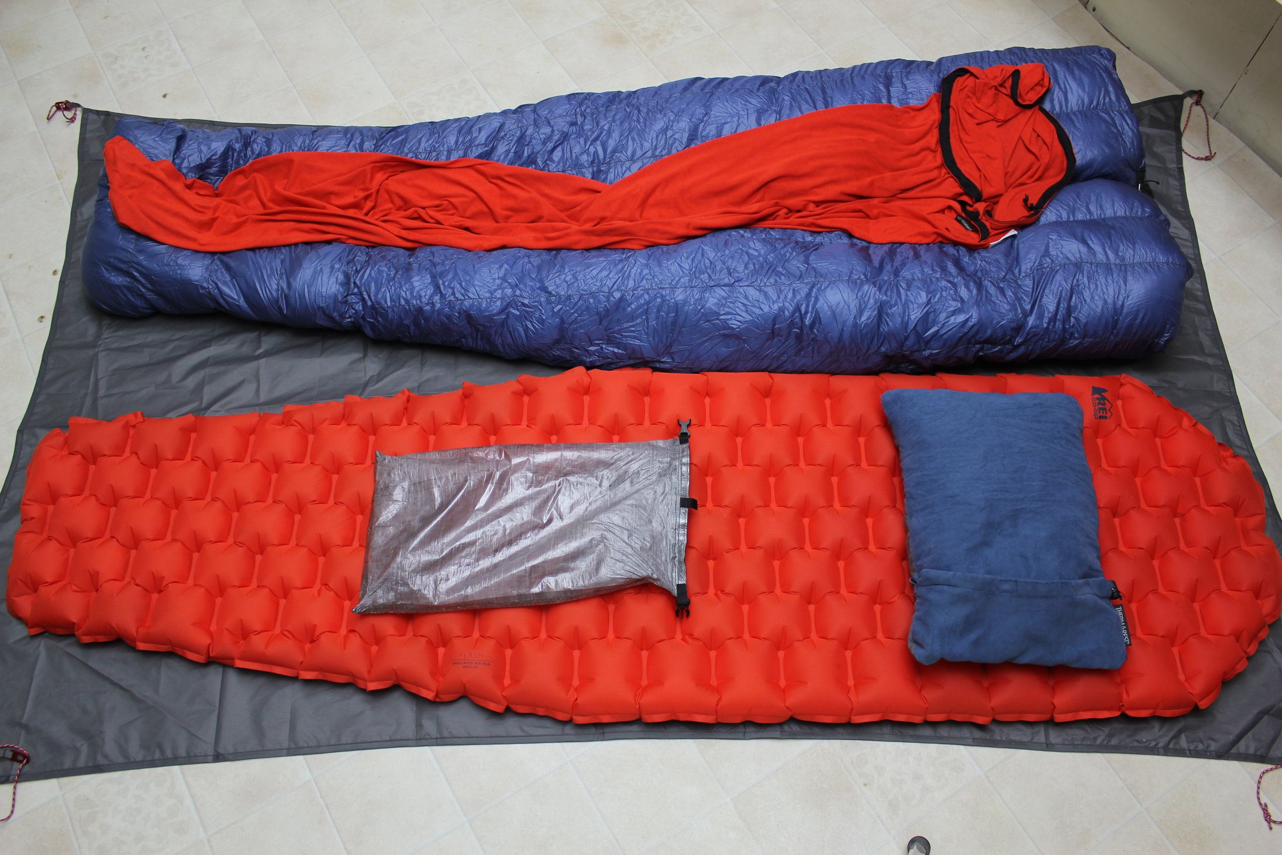Z-Packs Classic Sleeping Bag = 20 oz  Sea-to=Summit Thermalite Reactor - Sleeping Bag Liner - 14 oz  REI Flash Sleeping Pad - 1 lb 2 oz  Therm-a-Rest Compressible Pillow - 7 oz