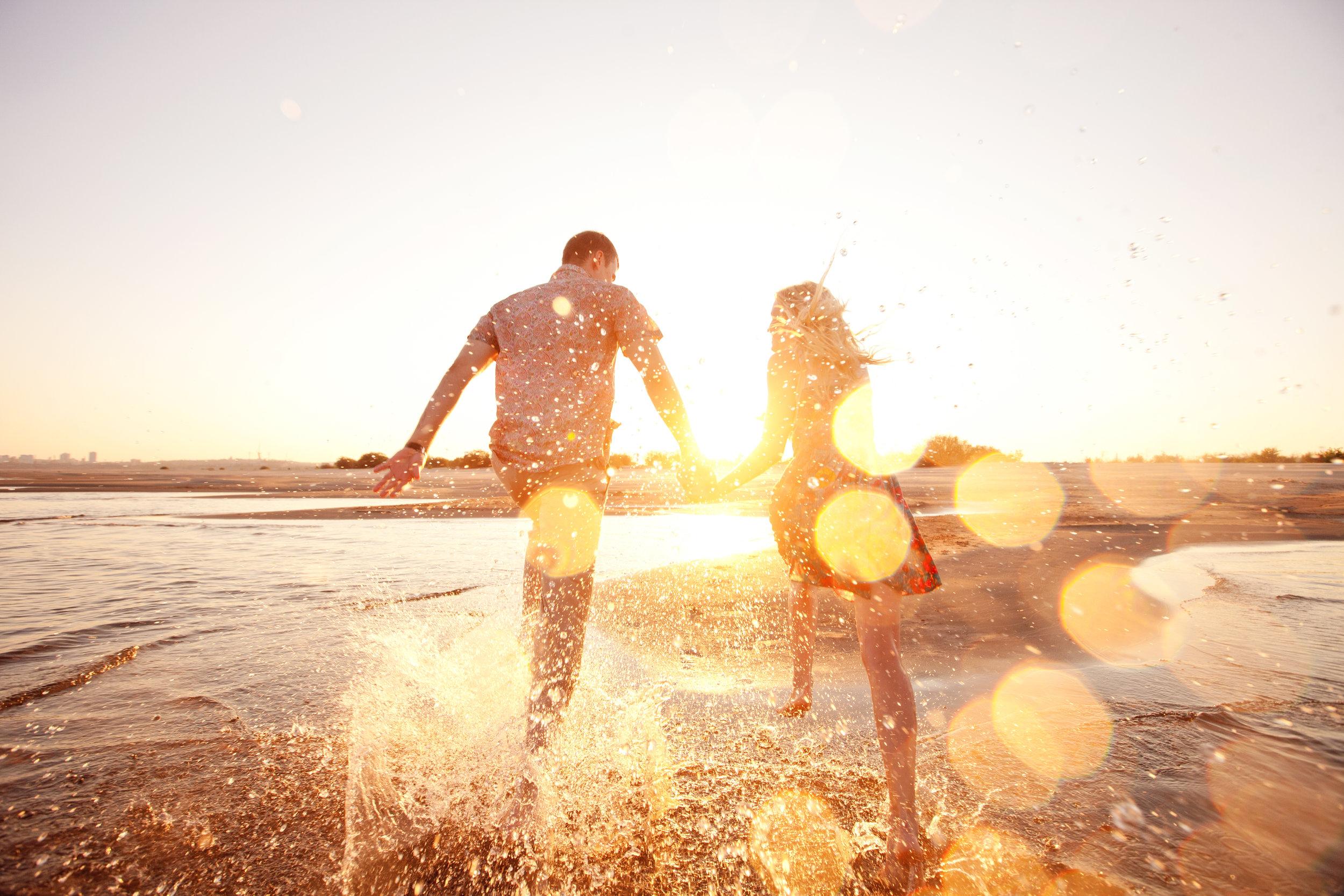 couple running on the beach couple running on the beach