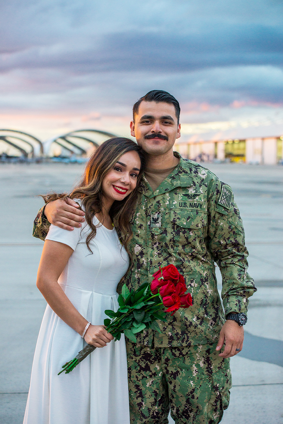 Seriously! Can you feel how content they are to be back together. I was crying behind the lens at this Navy Homecoming on NAS Lemoore. Photo by Lillian Short.