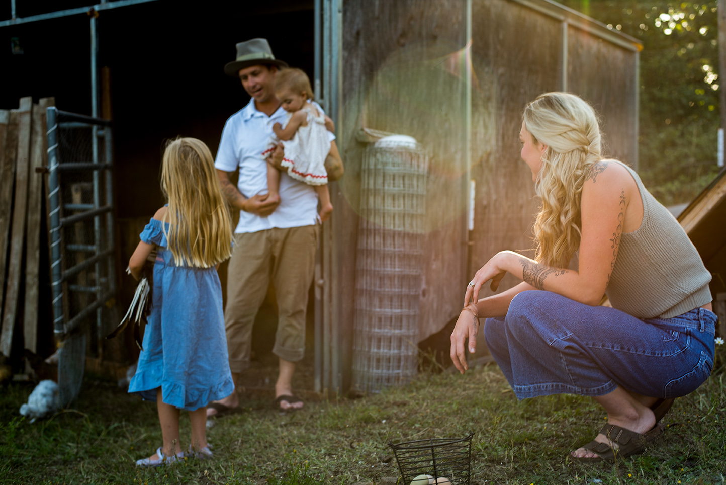 Family laughing in Kalama, Washington, at their home farm, photographed by Vancouver photographer Lillian Short.