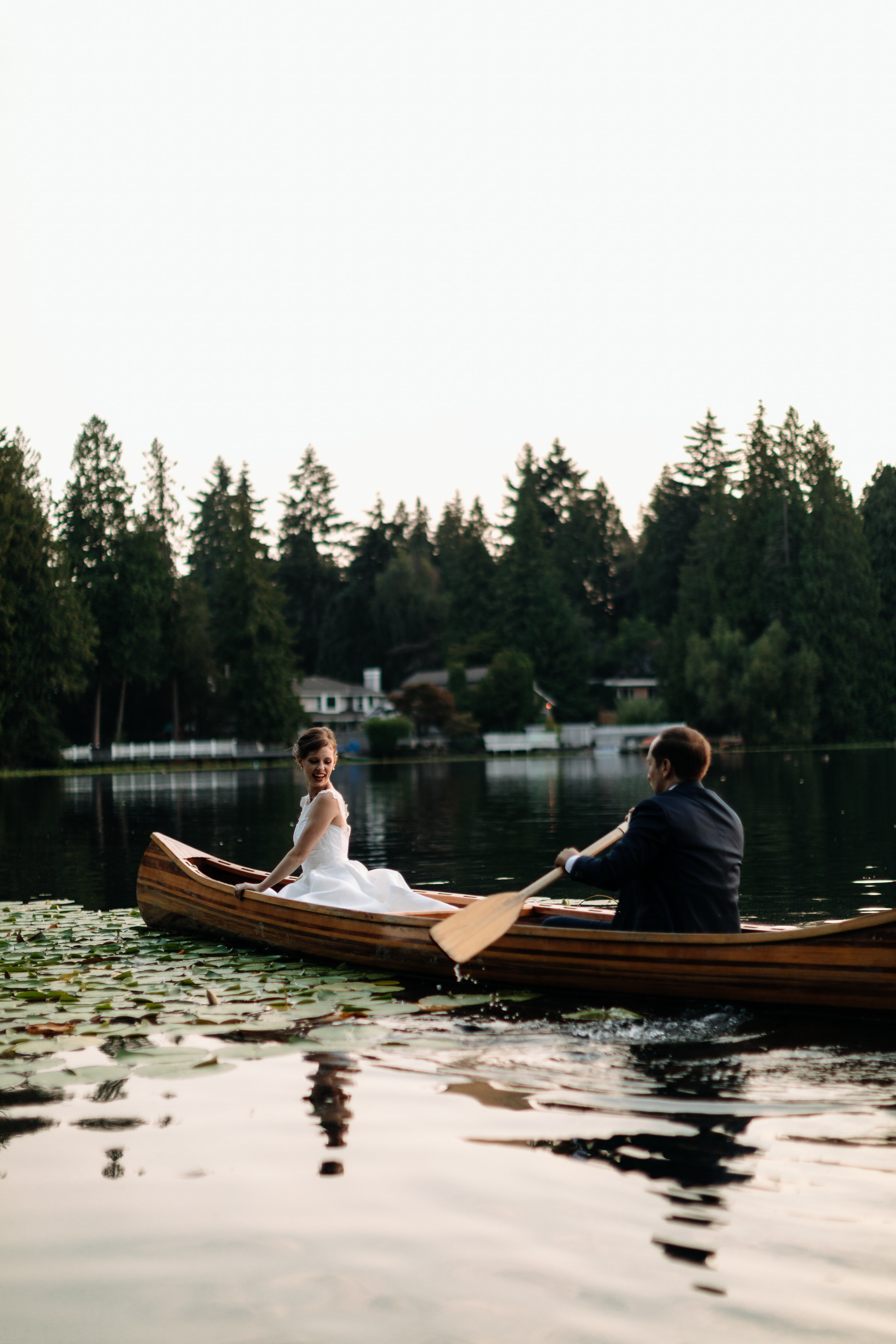 bride and groom on canoe