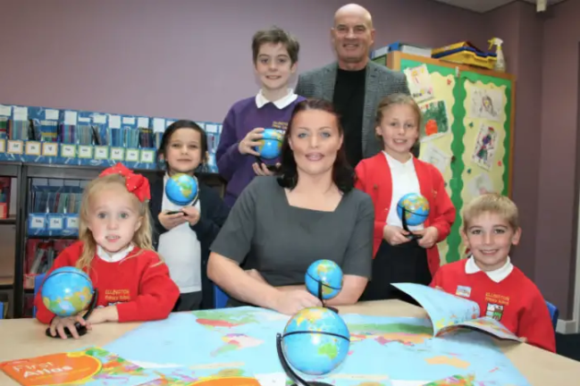 Ascent Homes marketing co-ordinator Robyn Murray, centre, with Kevin Vardy and Ellington Primary School pupils.
