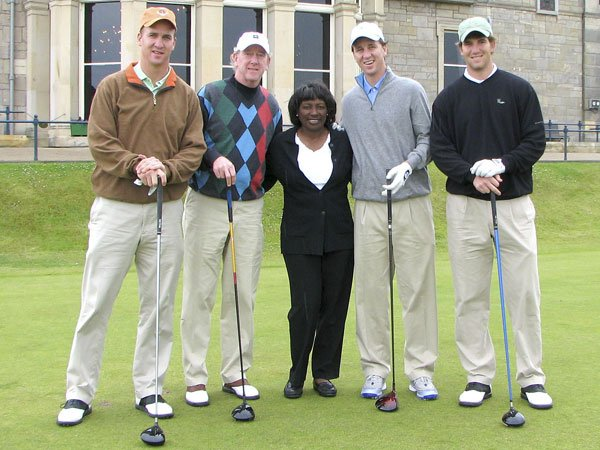 Renee Powell with famous football family, The Manning's in front of R & A in Scotland.