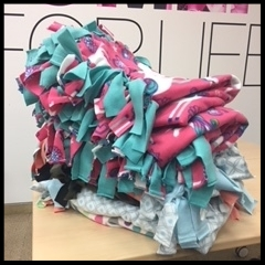 Handmade blankets for the Ronald McDonald House from Teams 3&4