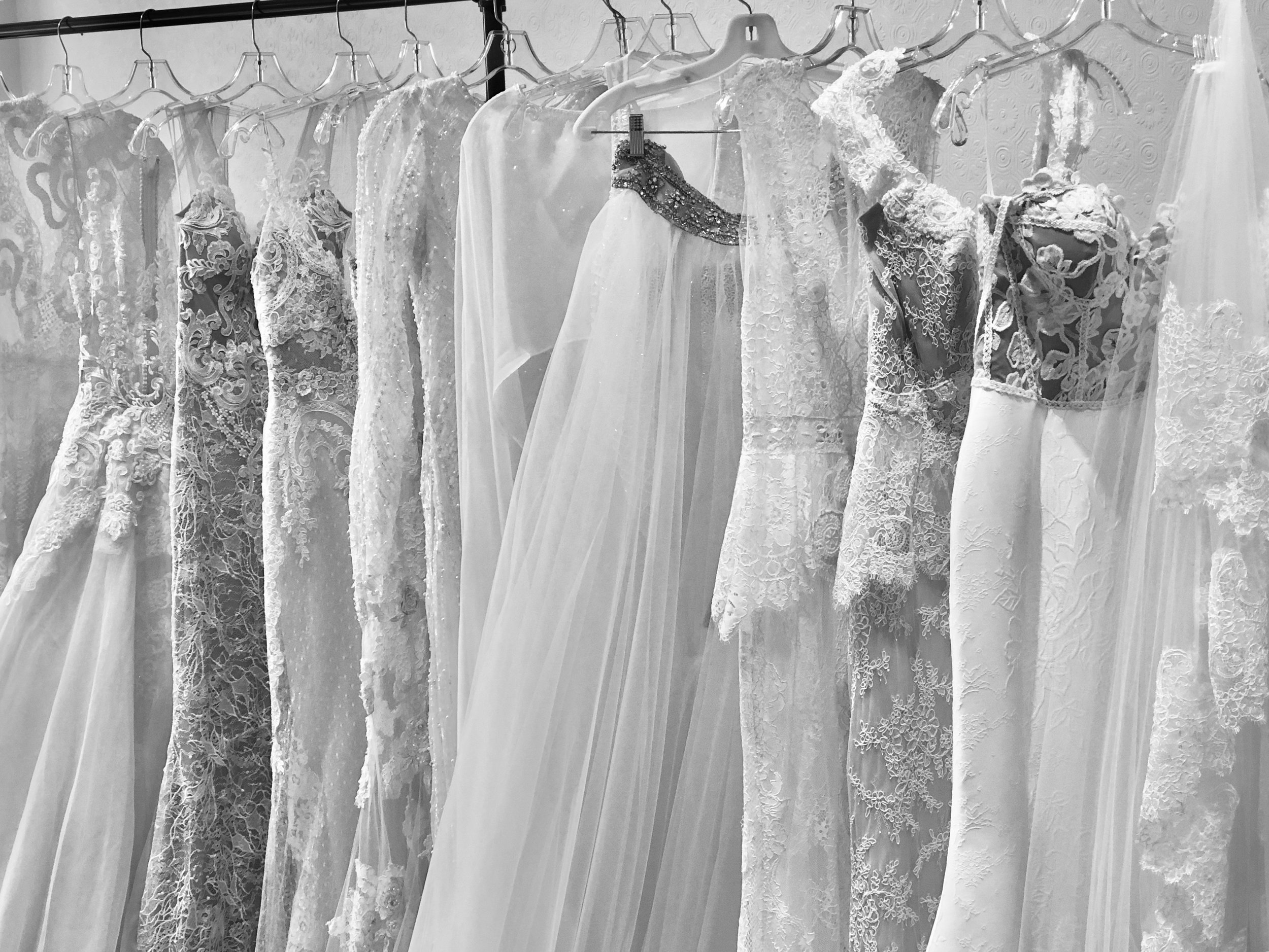 """#1) You Should Try On Dresses First - """"Once you've tried some on, you can take the bits and pieces that you liked best and use them as a sort of formula to create the gown of your dreams."""""""