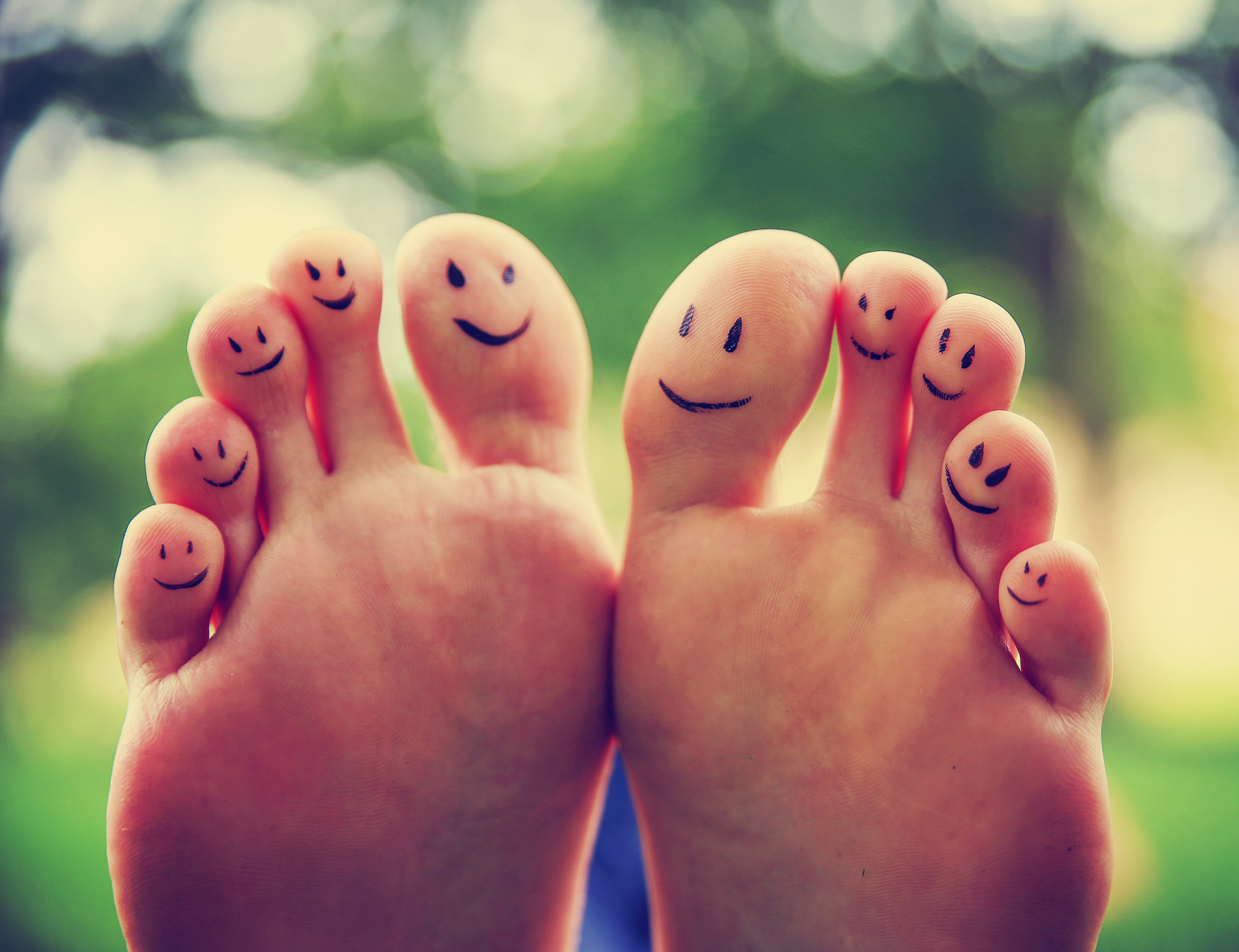 bigstock-smiley-faces-on-a-pair-of-feet-96220277.jpg