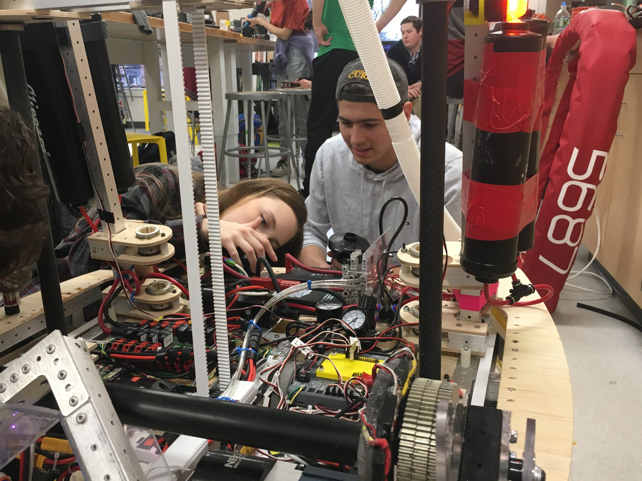 Maxine '19 and Connor '19 work on the robot during a Flex Friday.